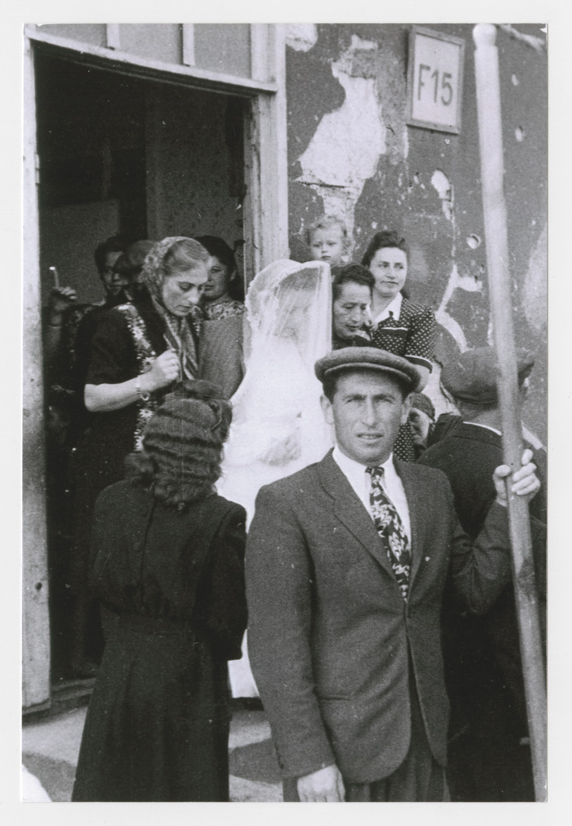 Nesha Leist Chamaides escorts her niece Szaindl Dudlesak to her wedding to Moses Goldfarb.  The two women survived together in hiding in the forest.
