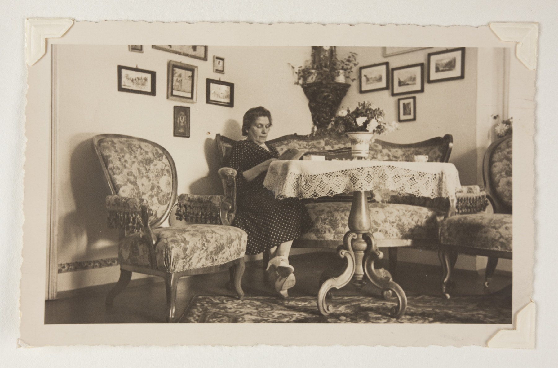 Therese Bloch-Bauer sits and reads in her parlor.