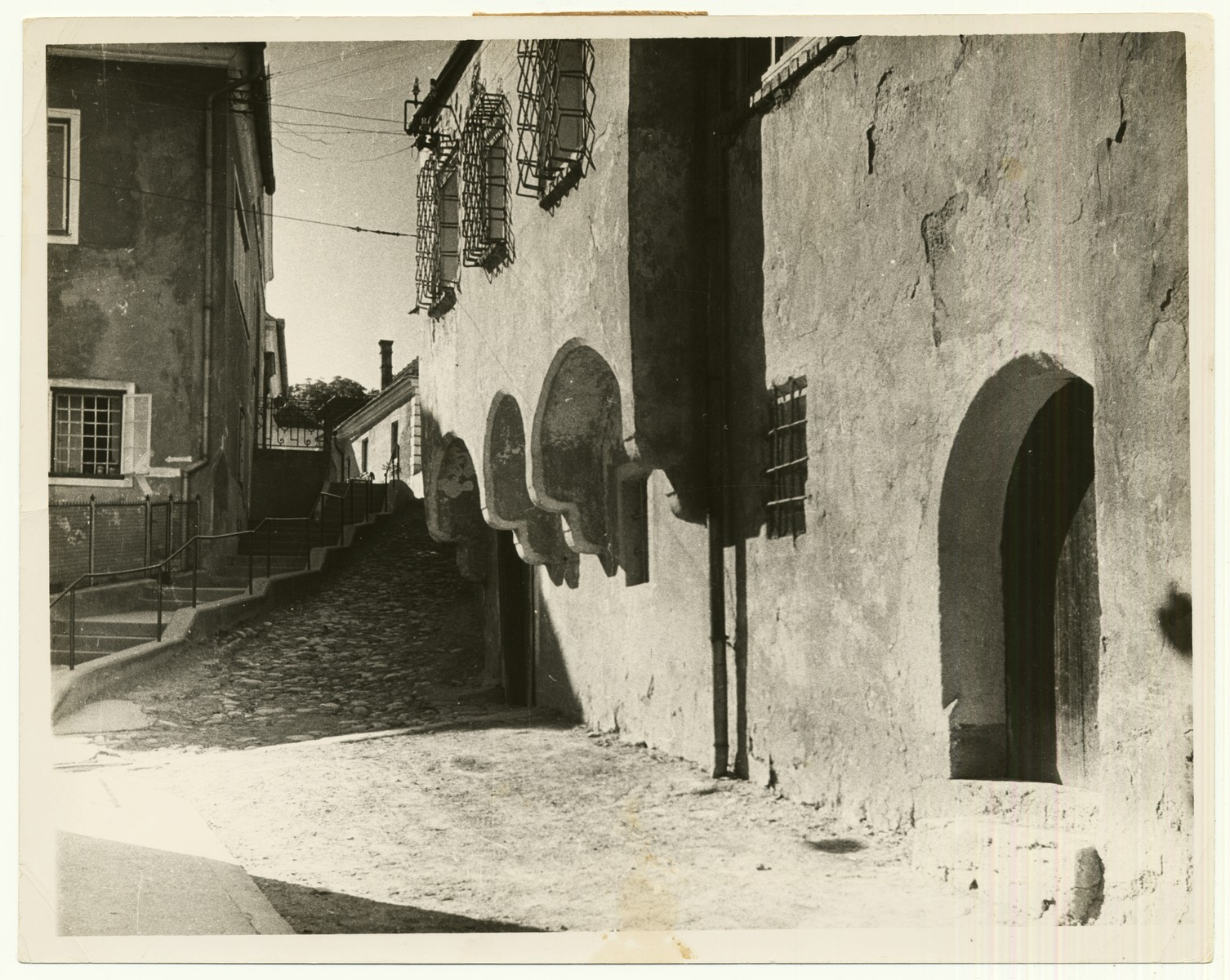 "Photograph of a street in Kremsmünster, Austria.  The handwritten caption on the back of the photograph reads: ""Street in Kremsmünster, Austria."""