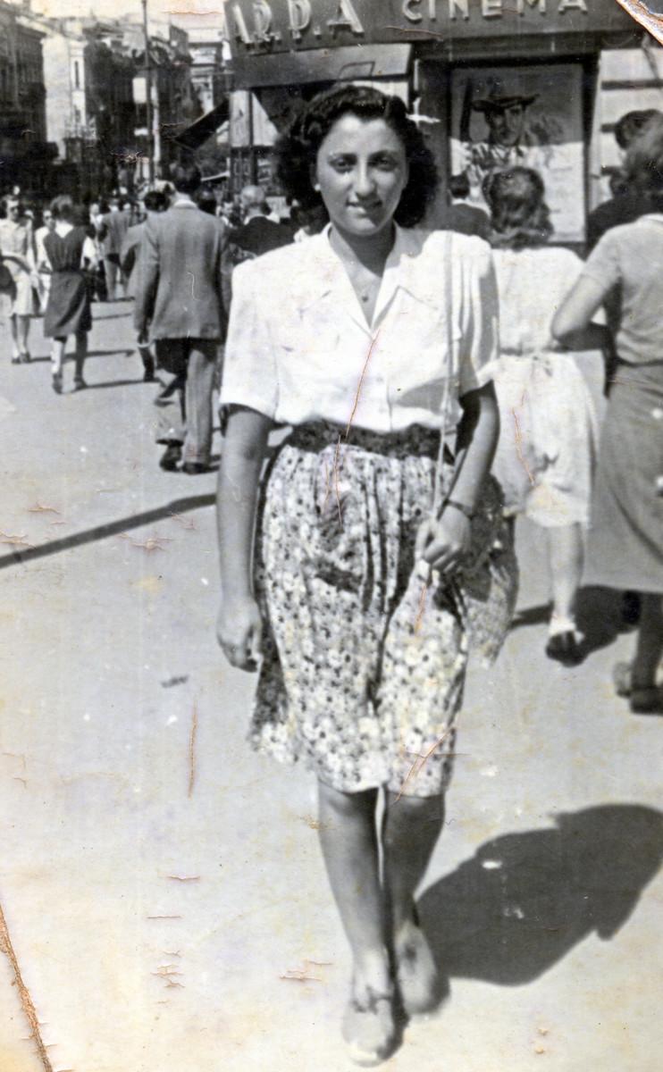 Thea Kollenberg walks down a street in Bucharest.