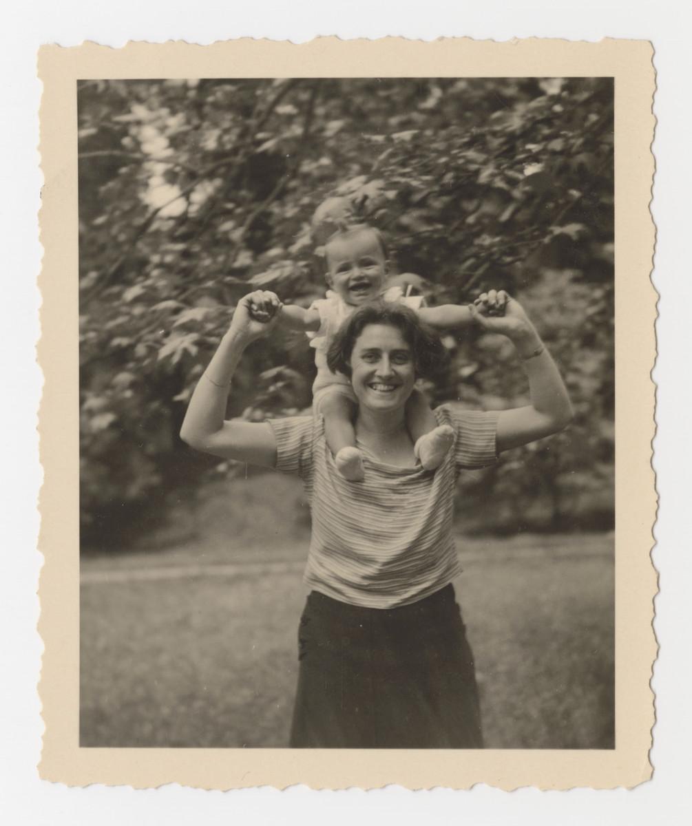 Klara Brecher poses holding her baby son Heinz on her shoulders in Graz, June 2, 1933.