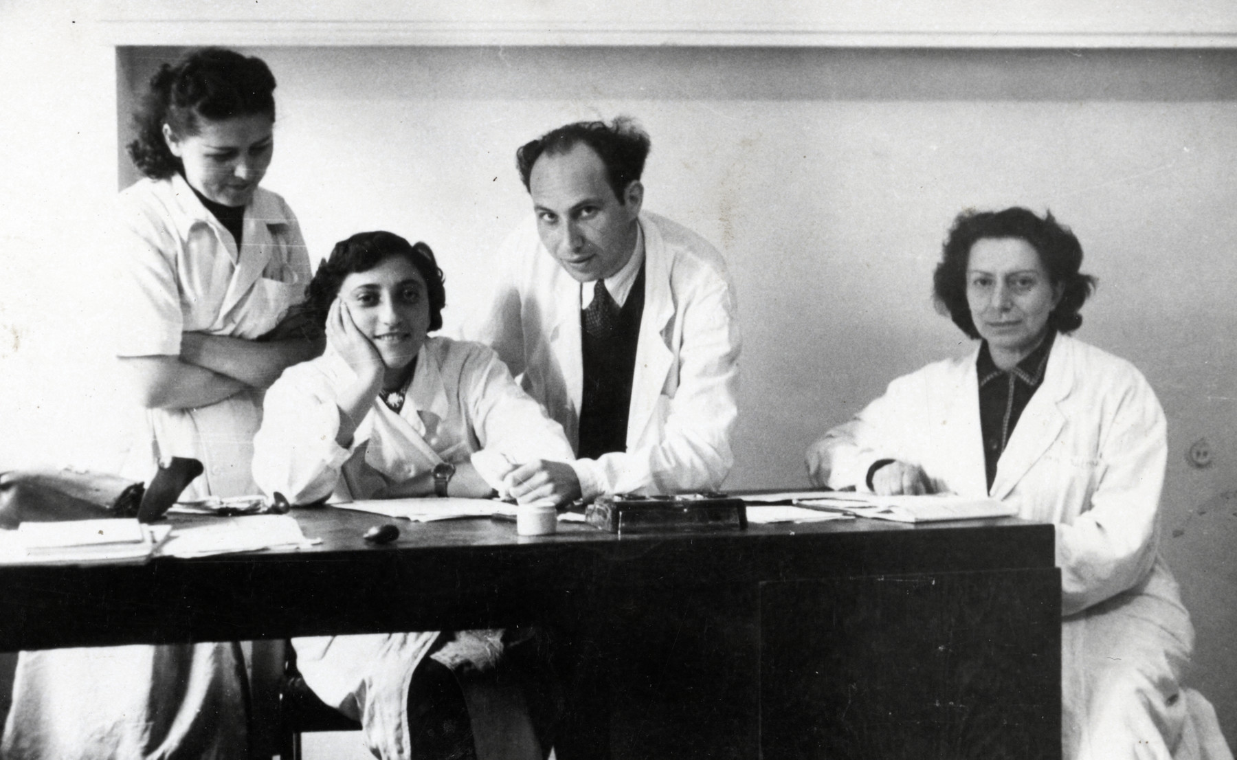 Group portrait of four students at the Bucharest Medical School.  Thea Kollenberg is pictured second from the left.