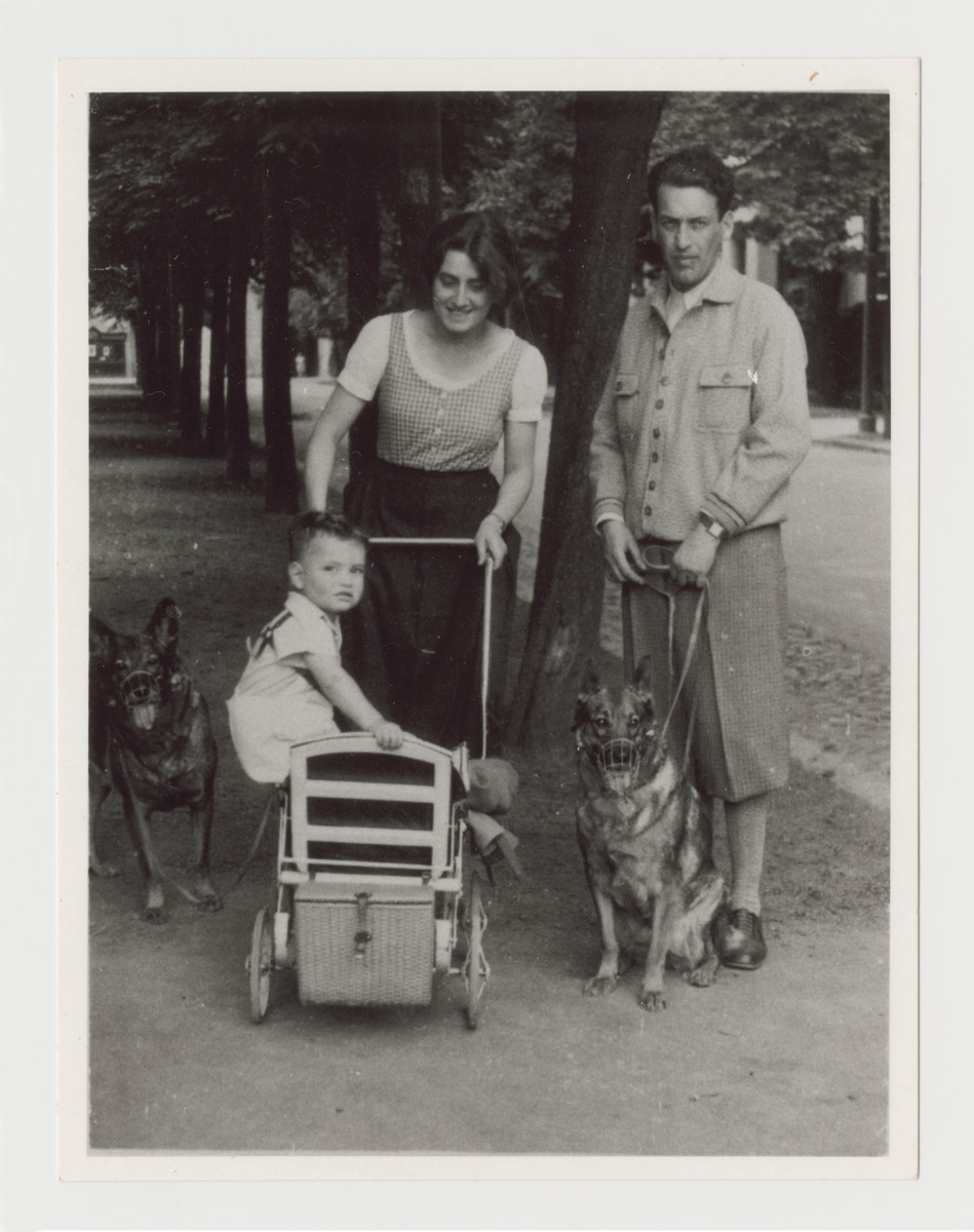 Ernst and Klara Brecher go for a walk in the park in Graz, circa 1934 with their son Heinz and their dogs.