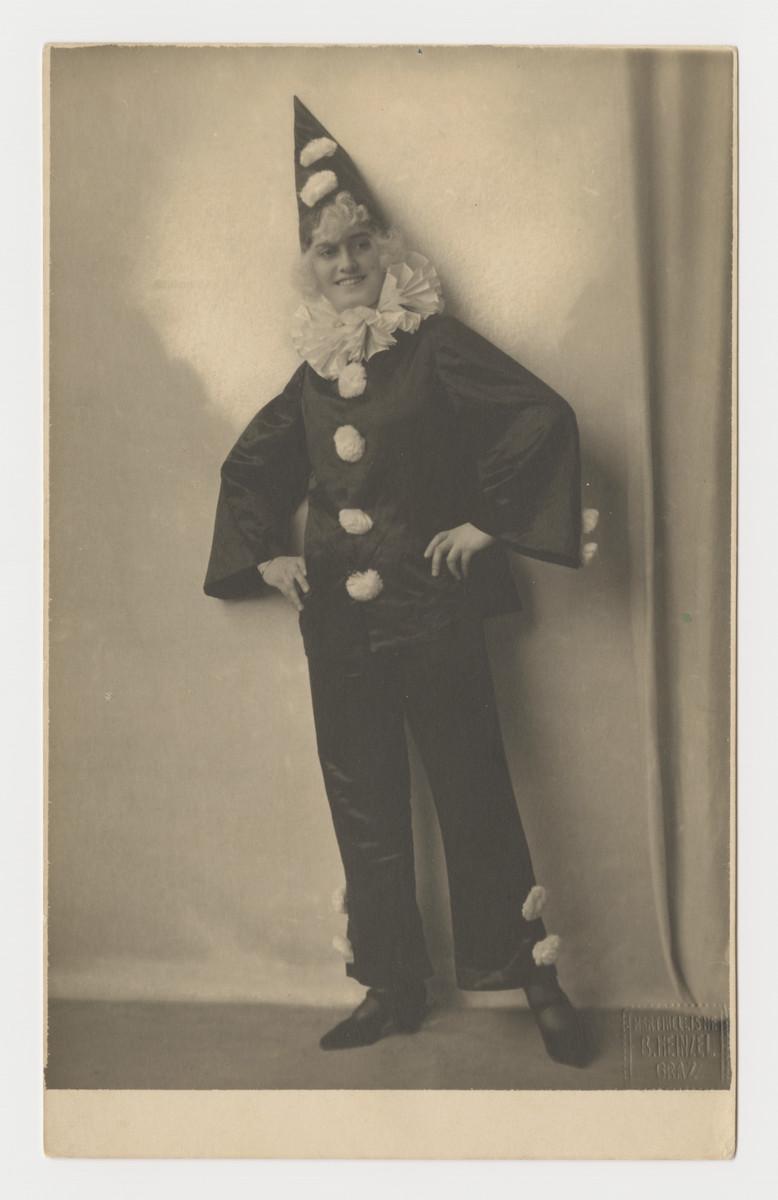 Close-up portrait of Klara Taussig wearing a clown costume, 1920s.