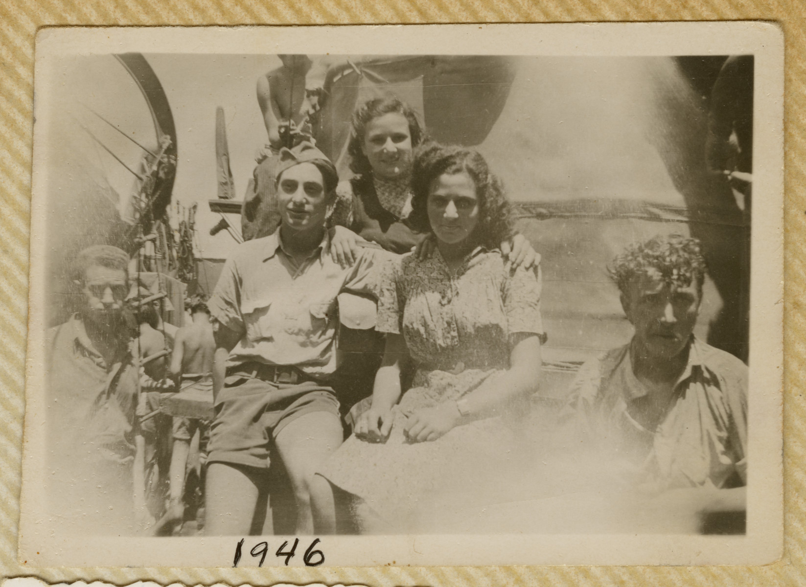 Jewish refugees pose on the deck of the Biriah while en route to Palestine.    Pictured in the center are Robert, Miriam Ofer and Alitza.