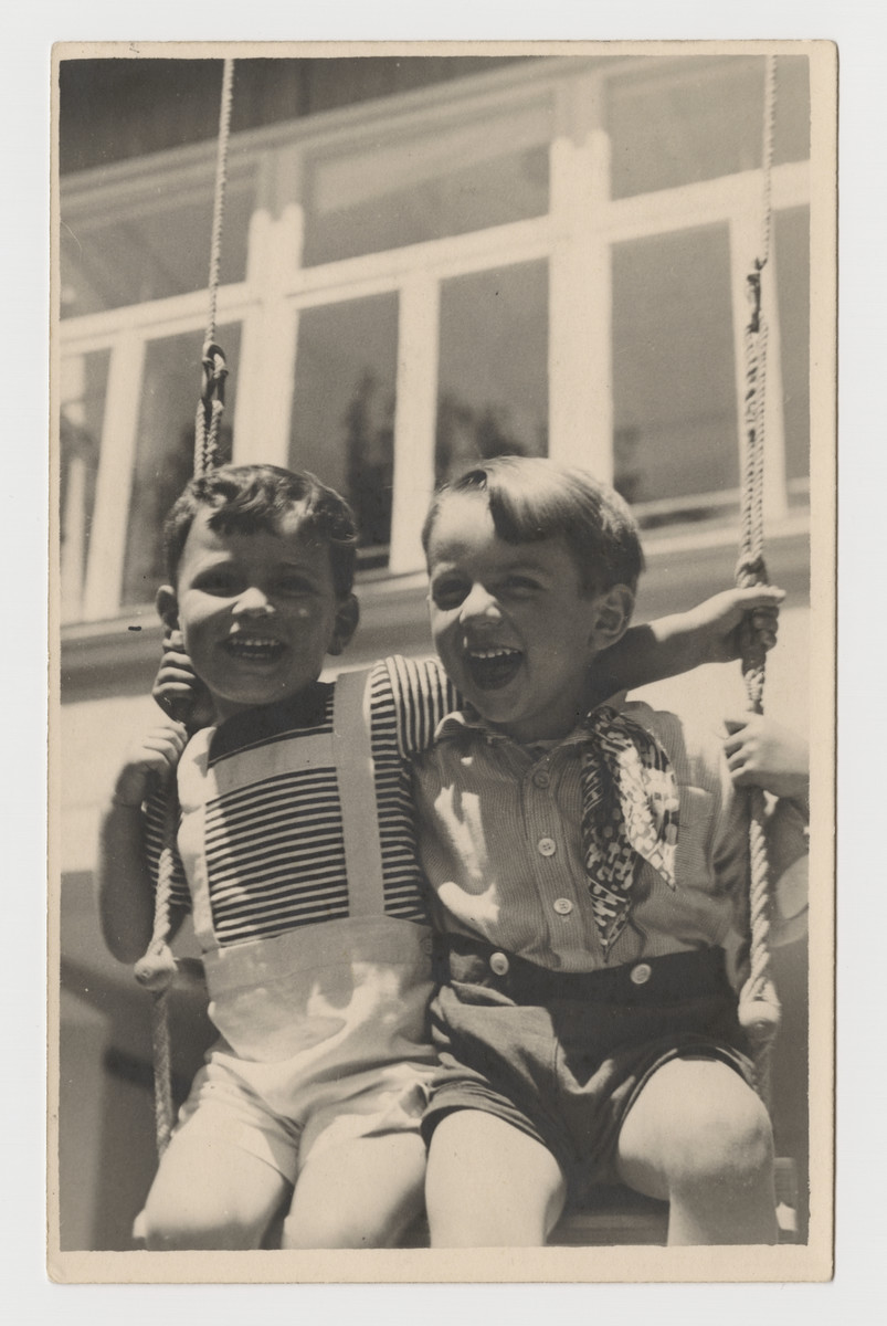 Two young boys share a swing in Graz, circa 1937.  Pictured are Heinz Brecher and his future foster brother, Alfred Rosenthal.