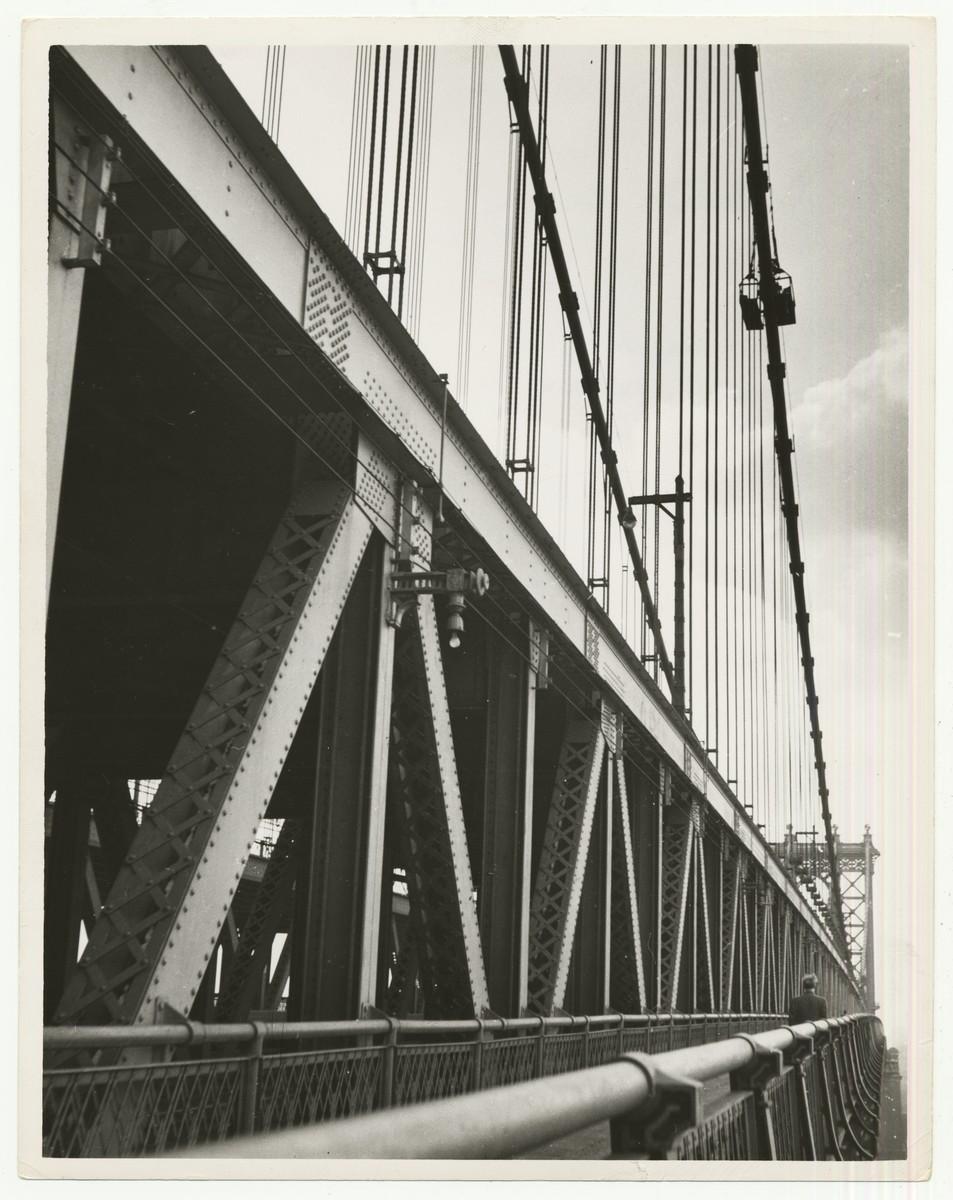 "View of the pedestrian walkway on the Manhattan Bridge, New York, NY.    The handwritten caption on the back of the photograph reads: ""Manhattan Bridge."""