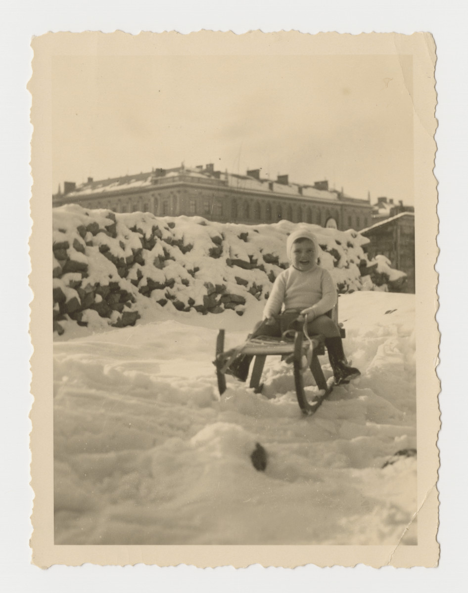Heinz Brecher goes sledding near his home in Graz.  The university can be seen in the background.