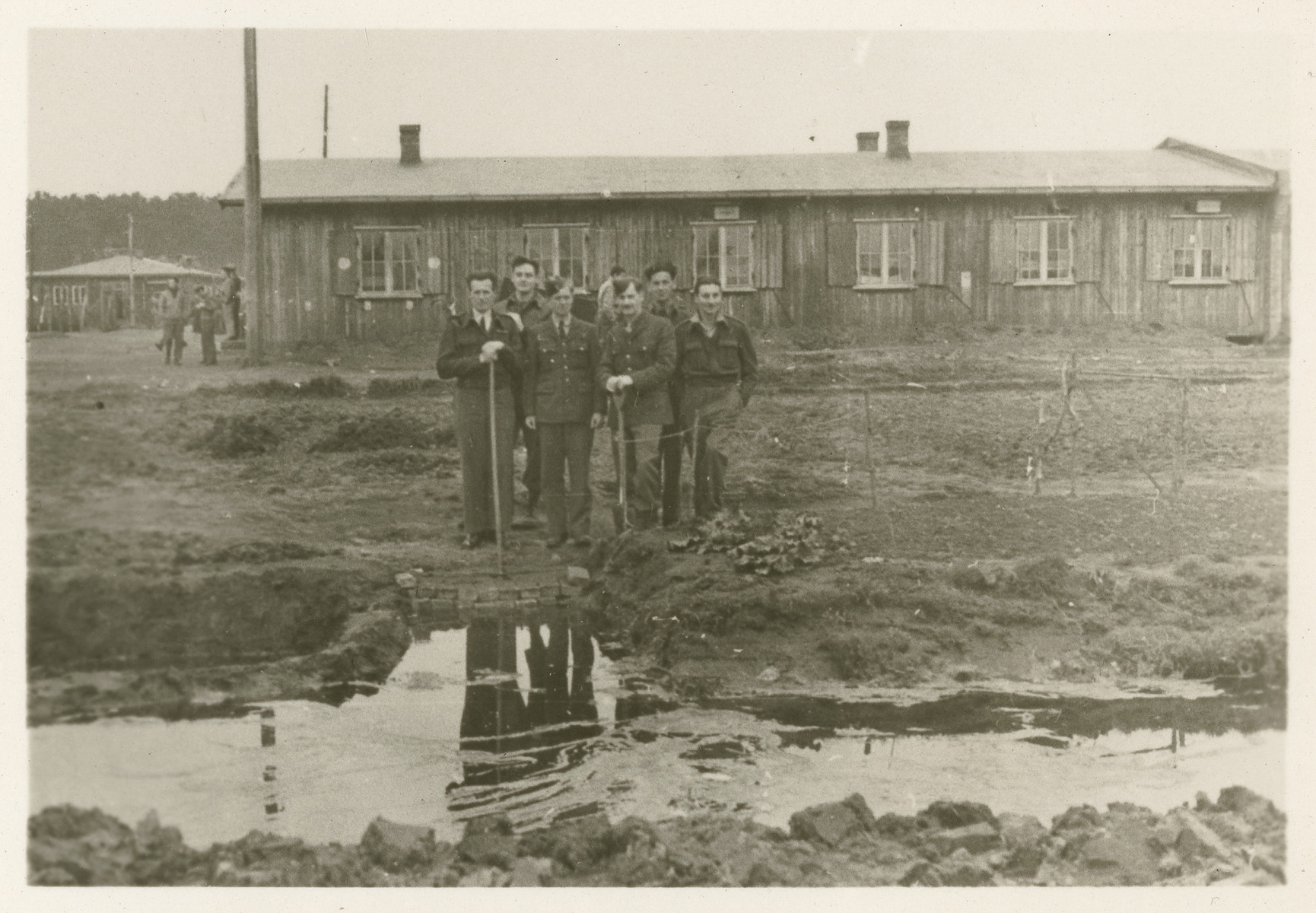 American POWs  stand outside a barrack in Stalag Luft 1.