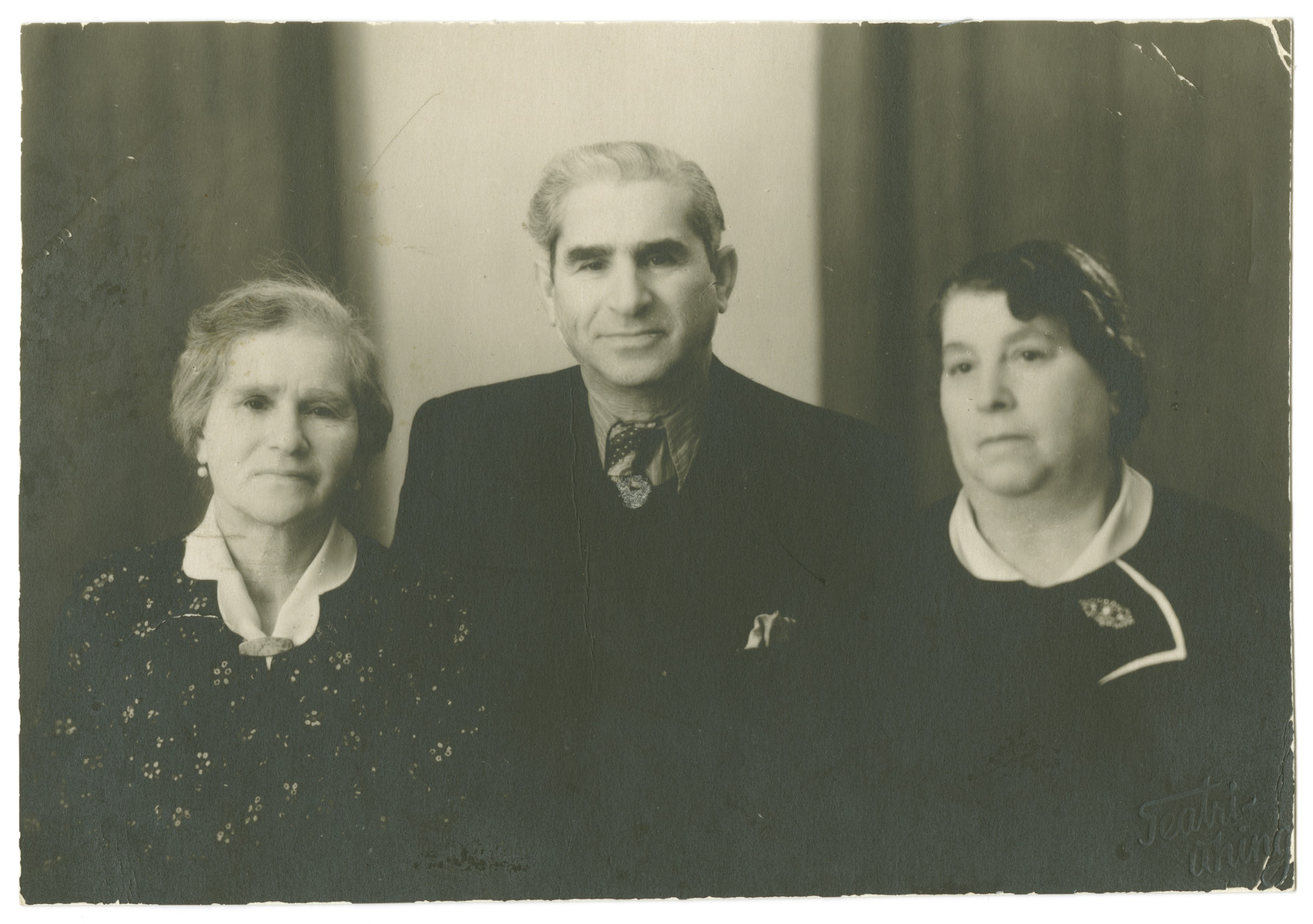 Portrait of the Aronovich siblings [?]in postwar Estonia.  Pictured from left to right are Roche Lea Meirtal, Jacob Aronovich, and Esther Kozolovsky.