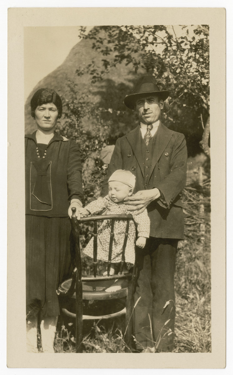 Portrait of a couple and their young baby [probably either the brother or sister of Jack Isaac].