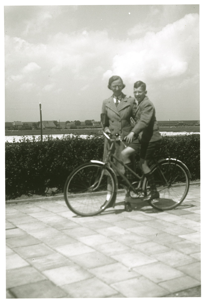 Max Heppner ridding a bicycle after the war. He is accompanied by [his mother].