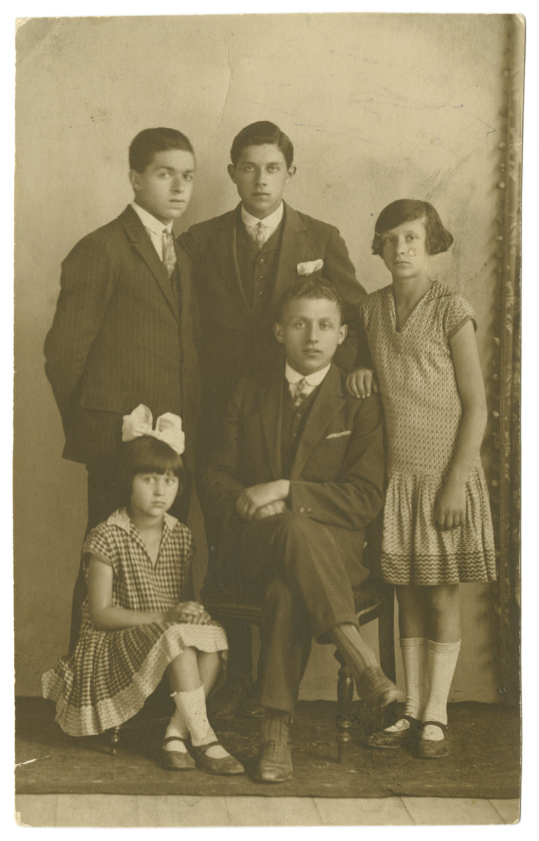 Portrait of the Meirtal siblings.  Pictured standing left to right are Peisach, Hirsch, and Deborah-Miriam; seated are Isaac and Shein-Chinde.