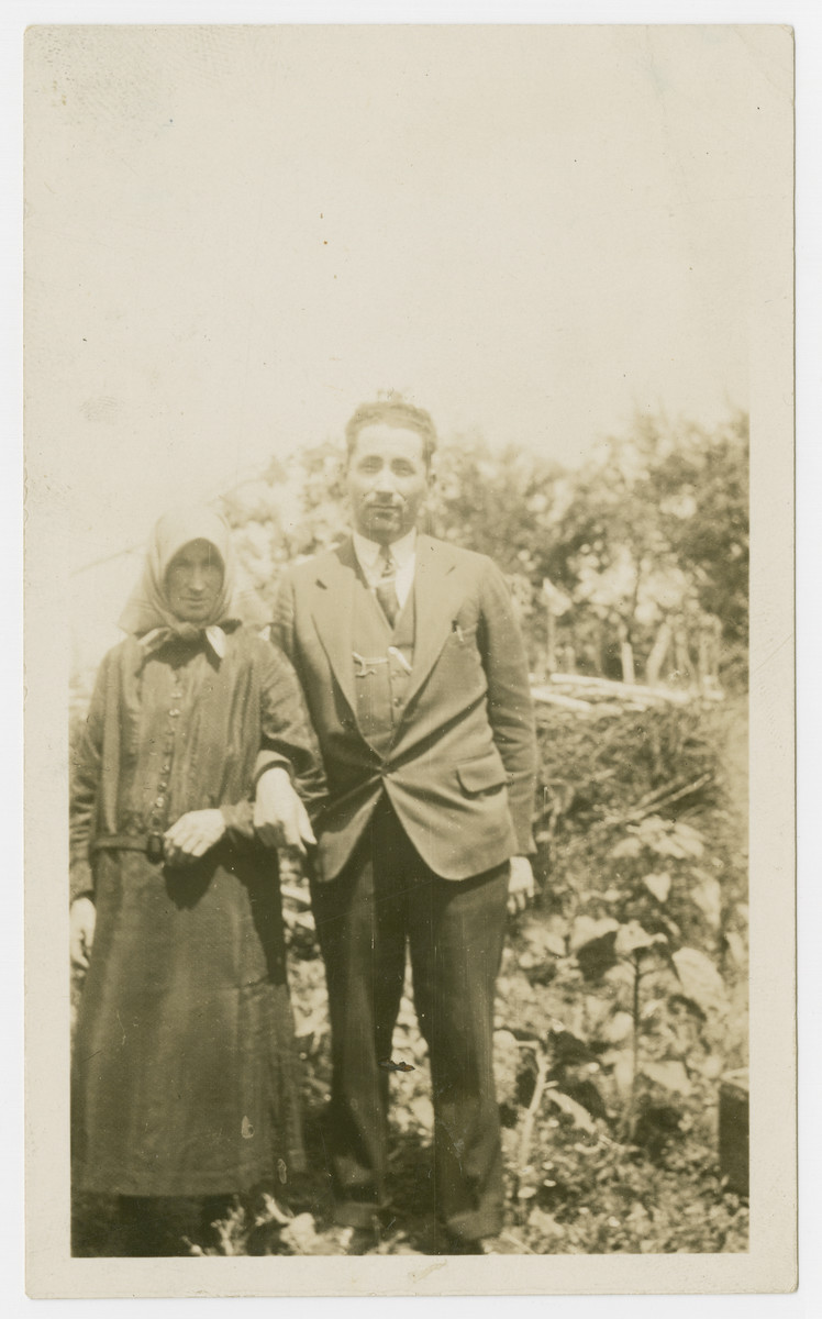 Jack Isaac stands for a portrait with his mother.