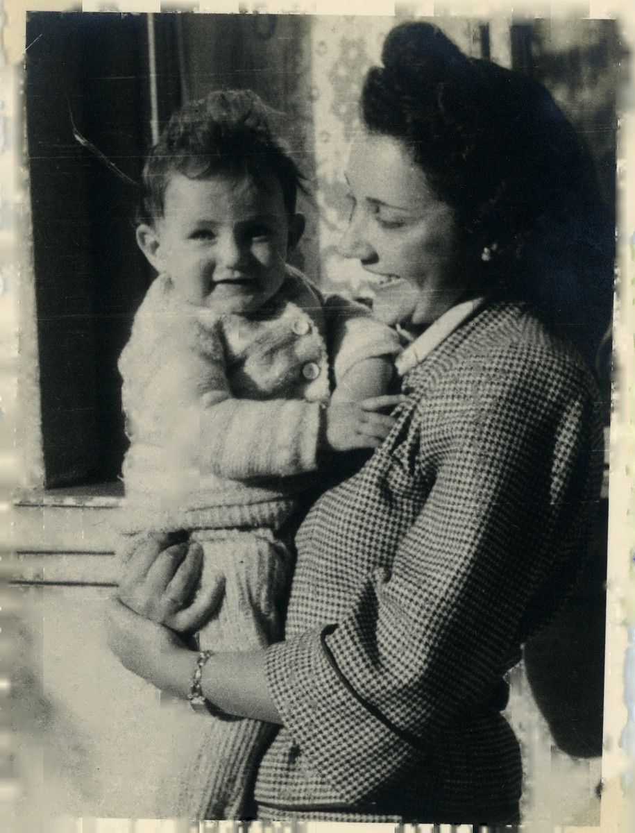 Anna Lenji poses with her baby daughter Judith after the war.