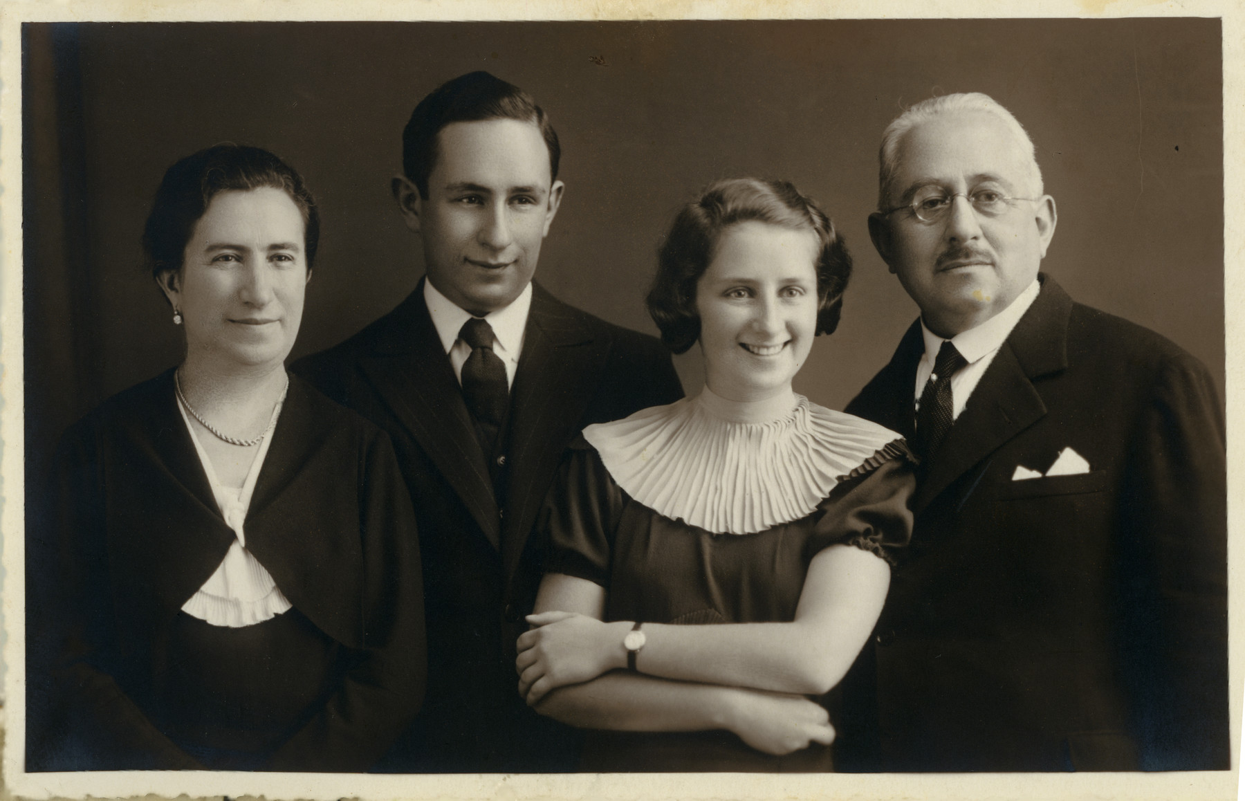 Studio portrait of the Lenji family.  Fromt left to right are mother Aronka, son Lorand, daughter Stephanie, and father Josef.