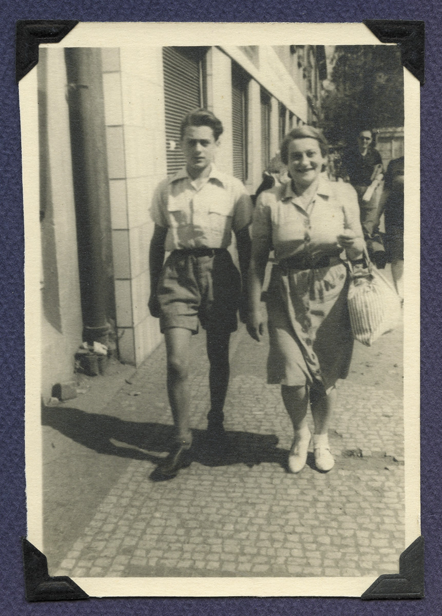 Michael Gruenbaum walks down a street in Prague with his mother Margaret shiortly before emigrating to Cuba.