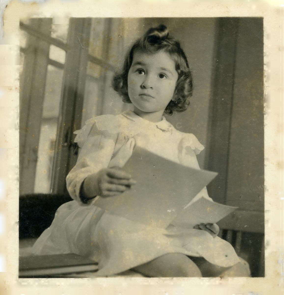 Studio portrait of Goldie Lenji (niece of Lorand Lenji) taken shortly before she was killed in Auschwitz.