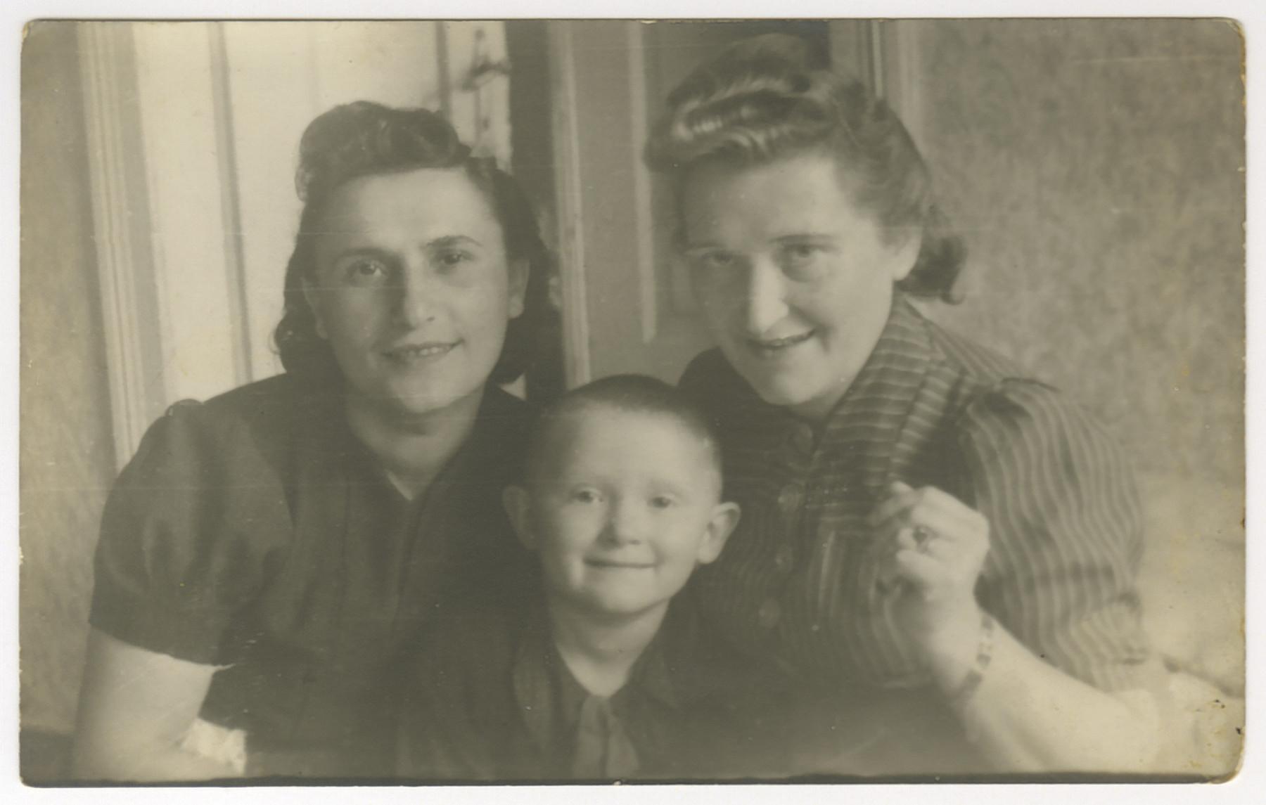 Hilda Jonisch, Michael Bornstein and Sophie Jonisch Bornstein pose together shortly after the war ended.