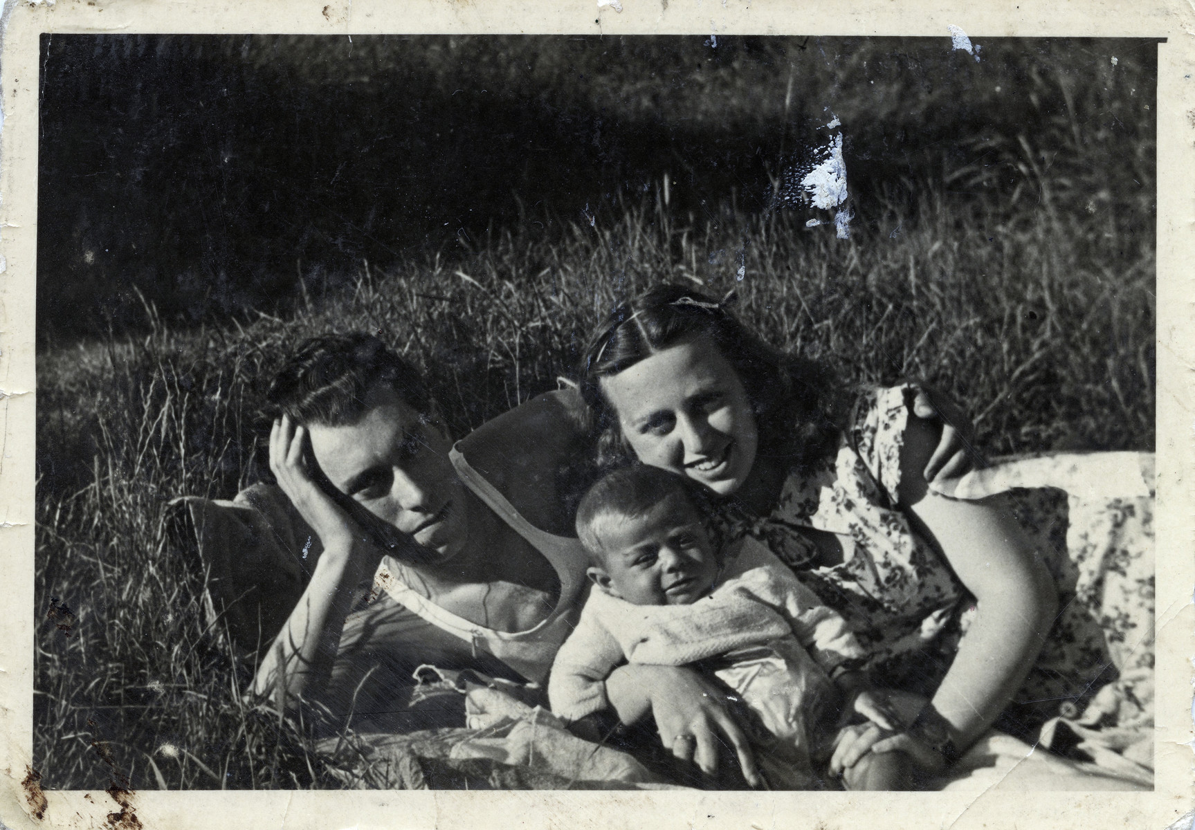 A Jewish family in the Cremona displaced person's Camp.  Pictured are Eugene and Kato Leibovitz with their son George.