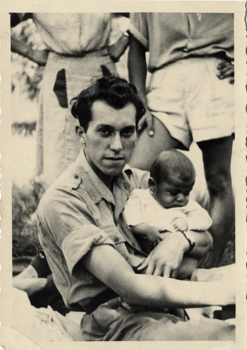 Eugene Leibovitz holds his son George n the Cremona displaced persons camp.