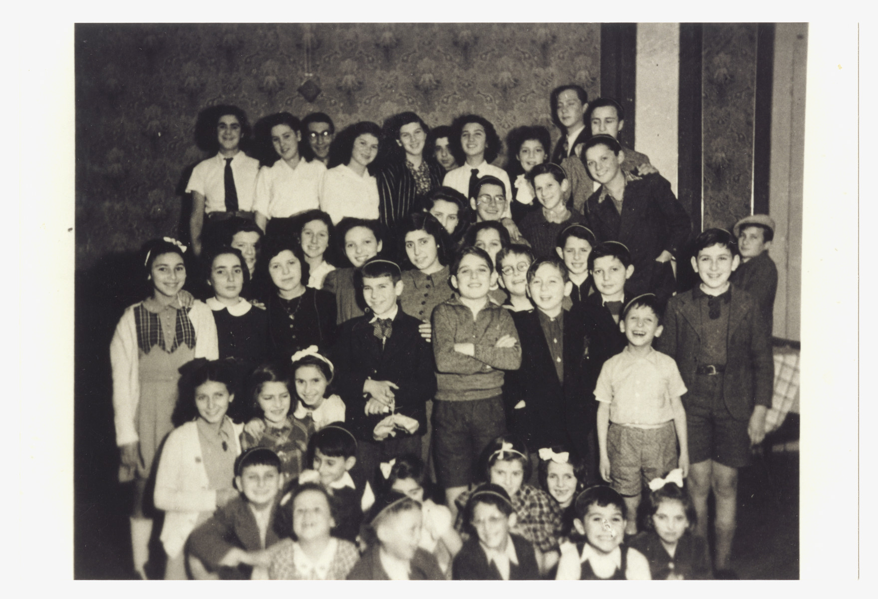 Group portrait of children in the Institut Ascher, a religious children's home in Switzerland.  Among those pictured is Joseph or Frederick Korpiel (second row, second from left).
