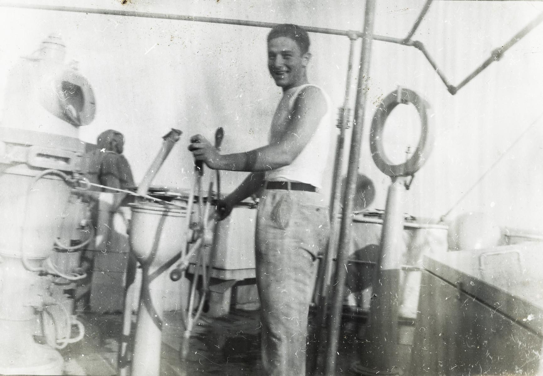 Murray Greenfield steers the wheel of the Hatikvah.