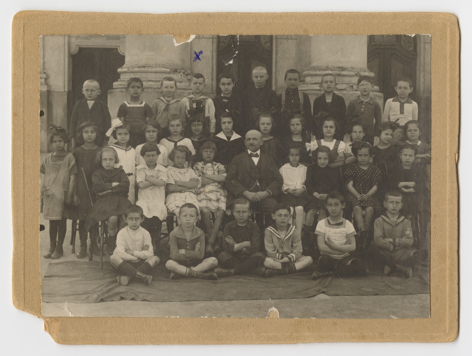 Children in the Jewish school in Liptovsky Mikulas pose outside the synagogue.  Erwin Schwalb (later Jan Sebor) is standing on the top row, fourth from the left.