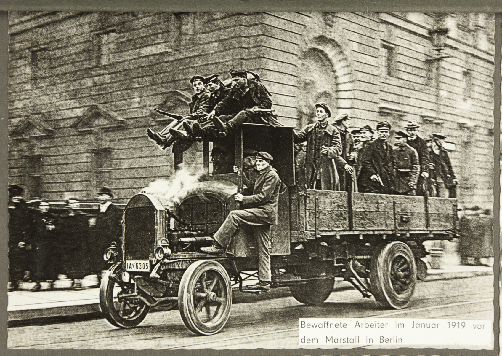 Armed workers ride in an open truck during the Spartacist Uprising.