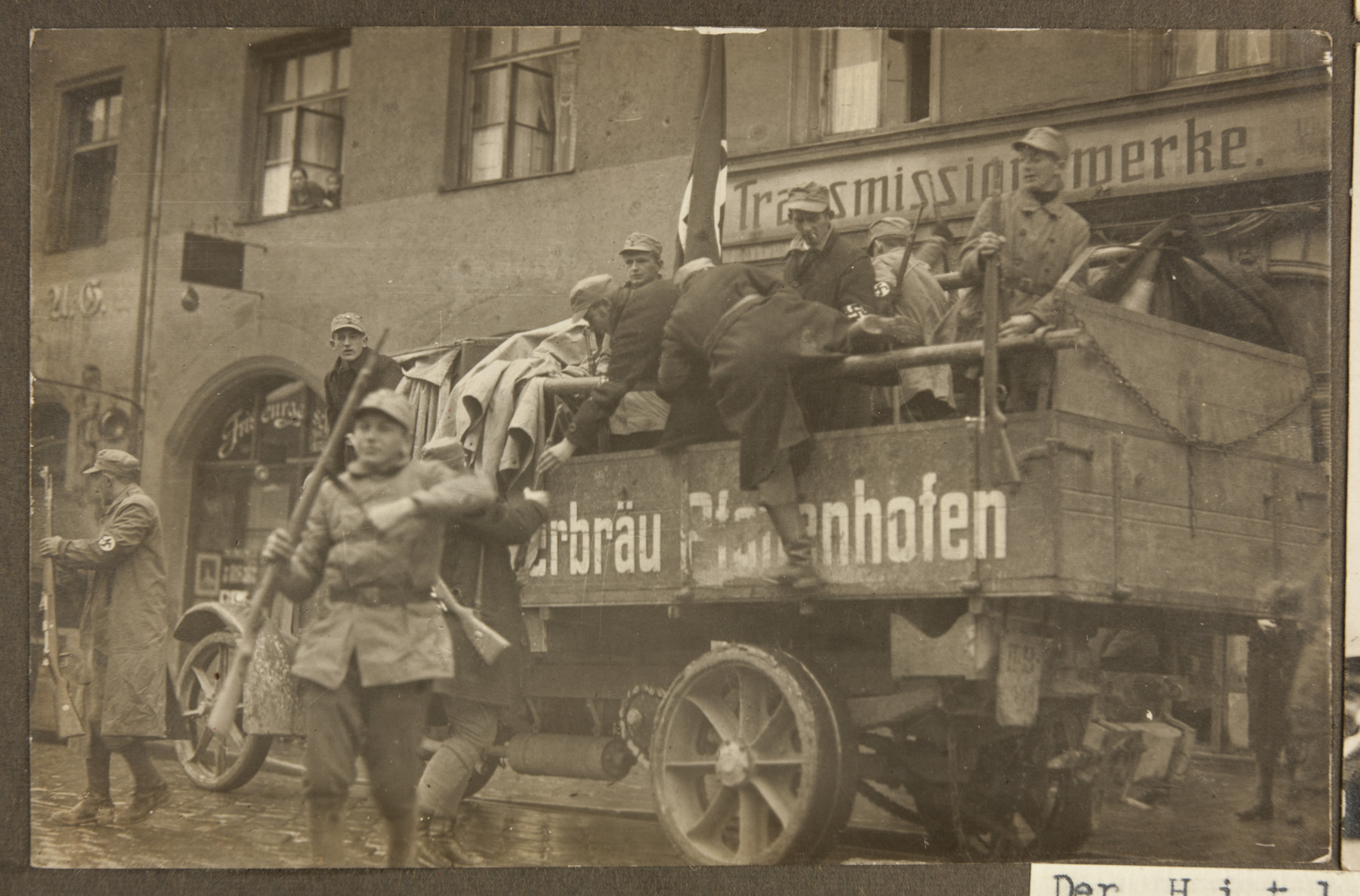Armed SA men pile out of a truck in to a Munich street during the Beer Hall Putsch.