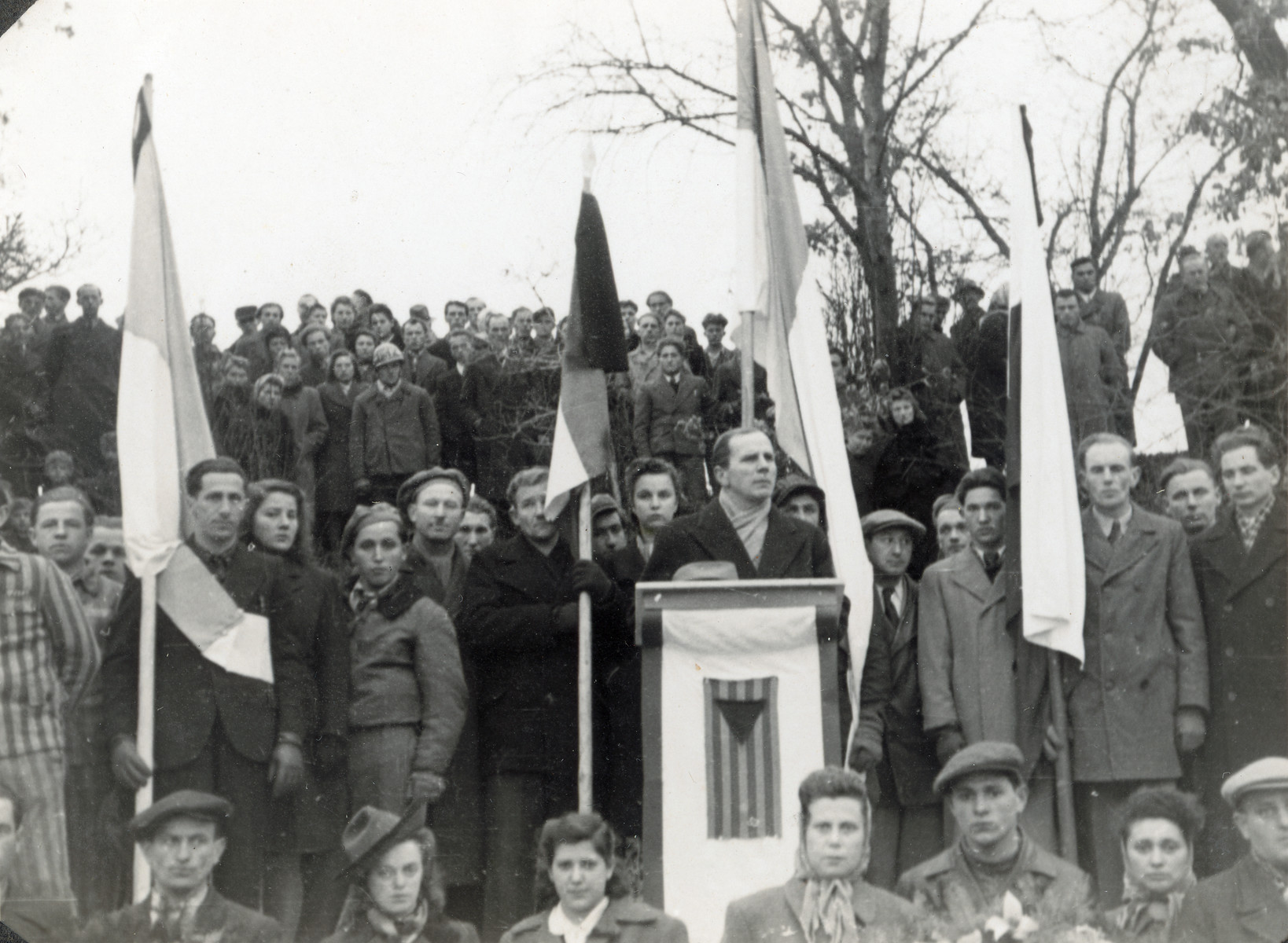 Survivors attend a dedication of the future monument to the victims of the Pocking concentration camp following the exhumation and reburial of the victims .