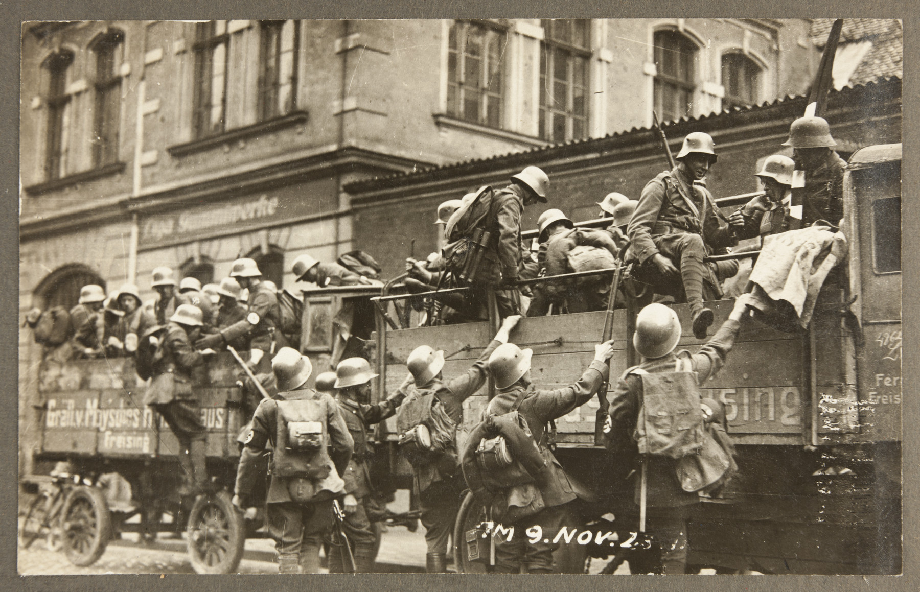 Armed SA men pile out of a truck in to a Munich city street during the Beer Hall Putsch.