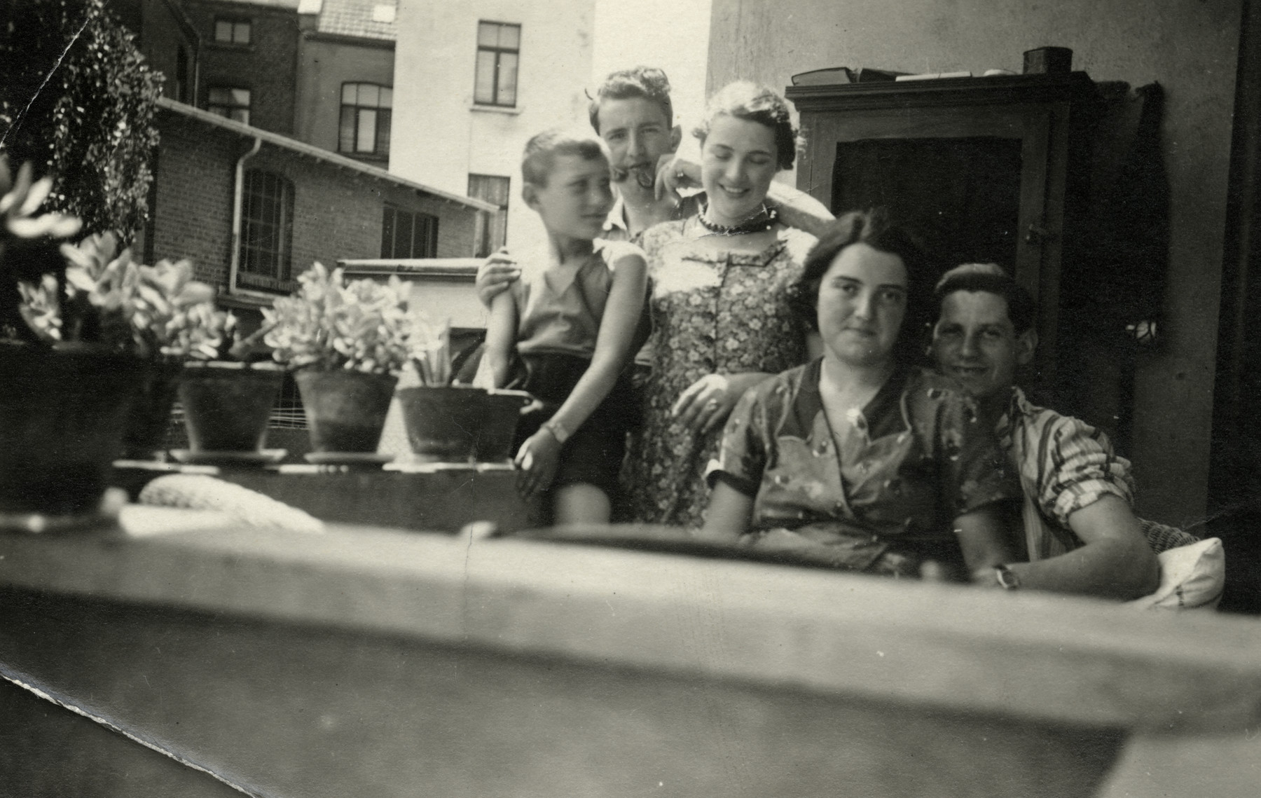 The Meyer children pose on the balcony of their home.  On the far left is Guss Meyer with his sister Erika and brother Herbert. On the right is Gus'older sister Theresa and her husband Carl.