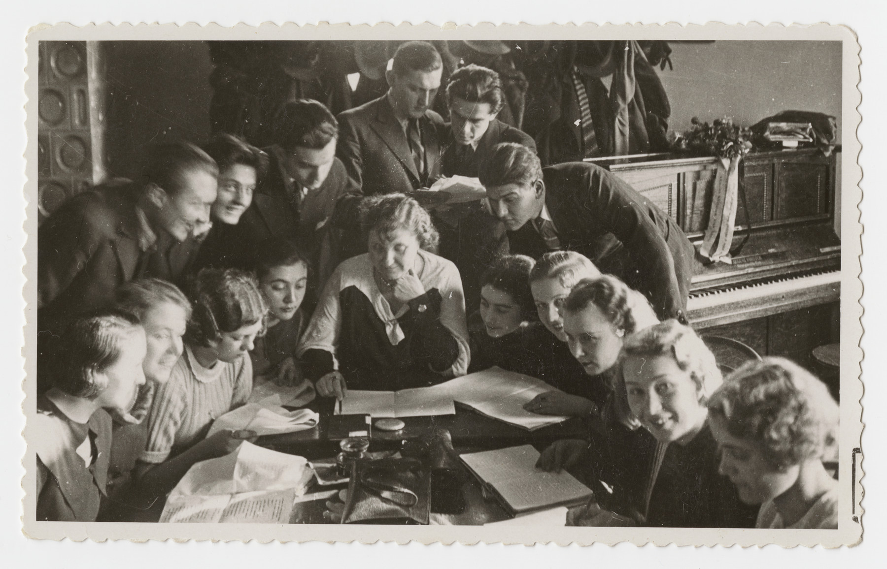 Students at the drama conservatory in Prague gather around a table.  Jan Sebor (Erwin Schwalb) is pictured standing third from the left.)