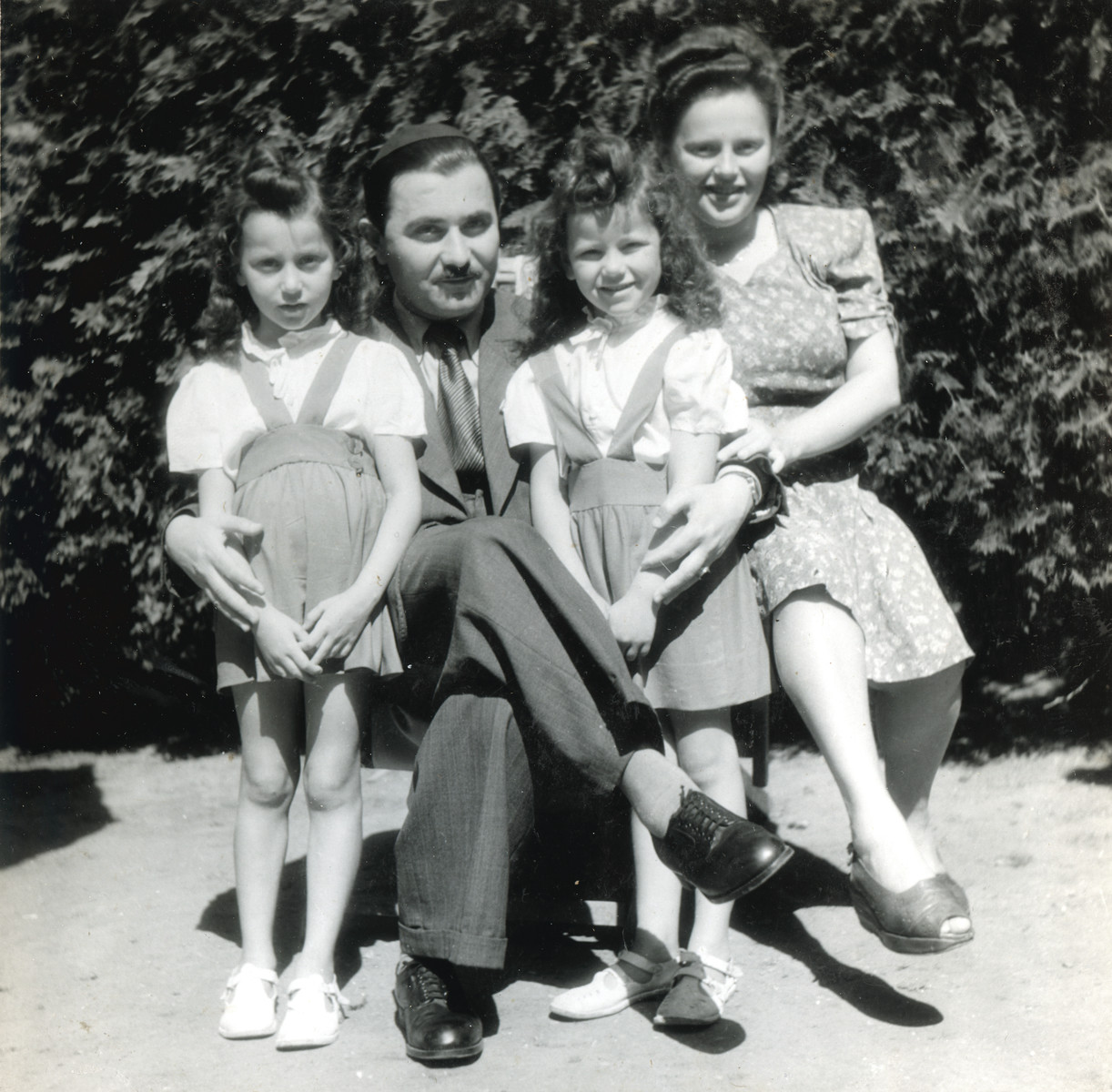 Rabbi Yehuda Lipot and Sara Meisels pose with their two daughters Yehudit (left) and Miriam (right) in the Pocking displaced persons camp.