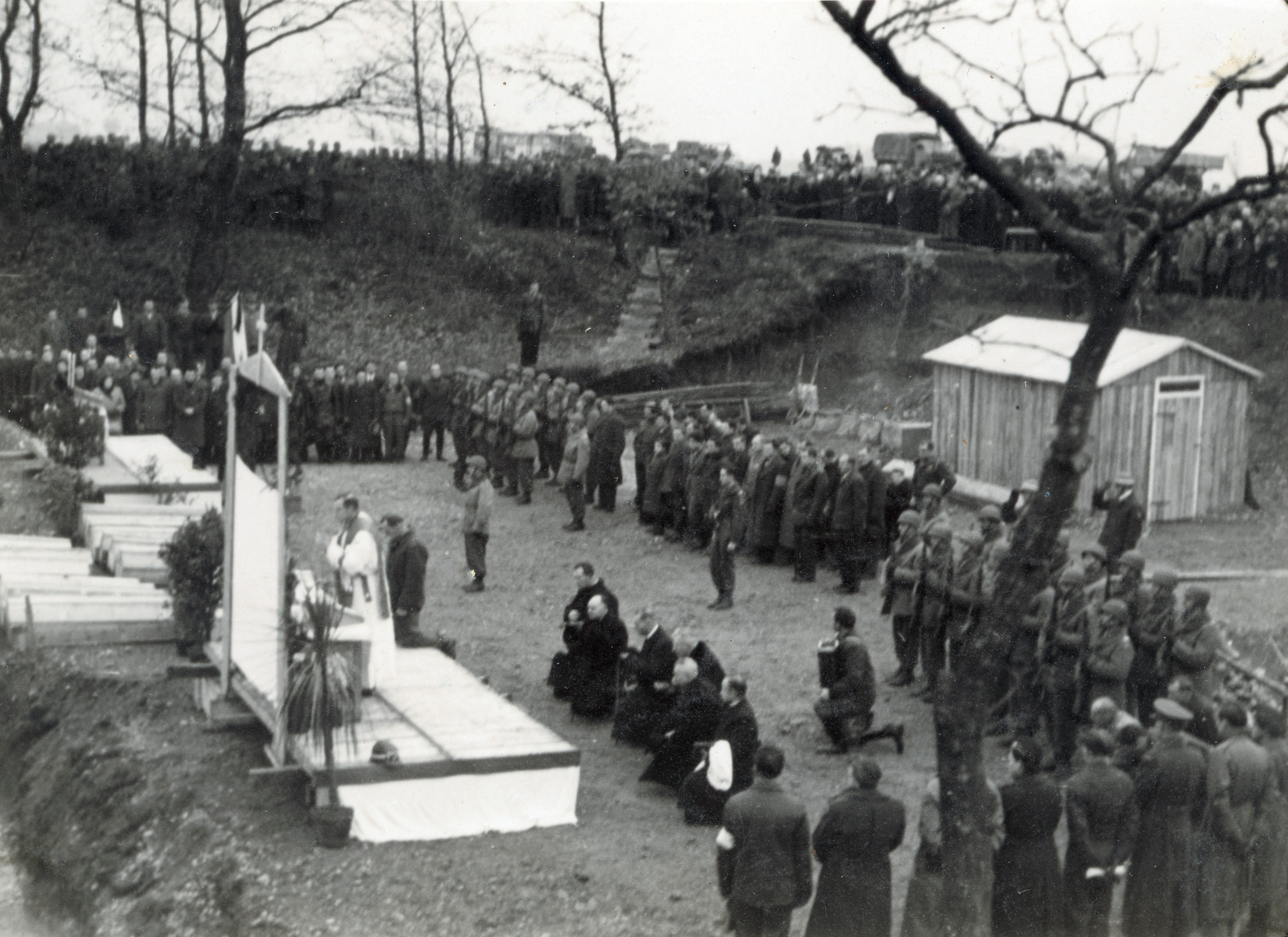 Priests lead a prayer service for the Christian victims of the Pocking concentration camp.