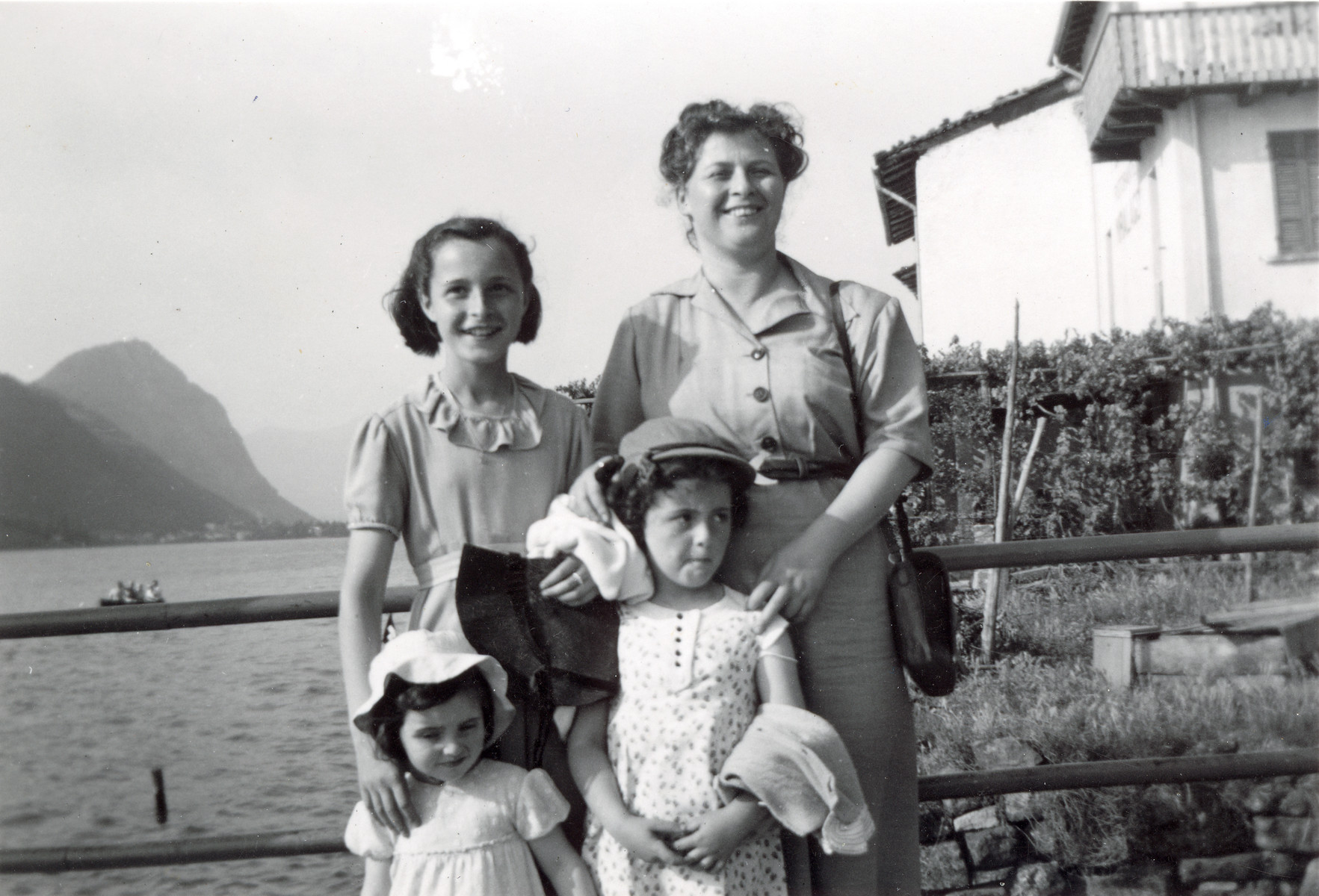 Toni Ermann poses on the shore of Lake Lugano with her three daughters.  Mirjam is standing top left next to her mother.  Henrietta pictured bottom left and Suzanne bottom right.