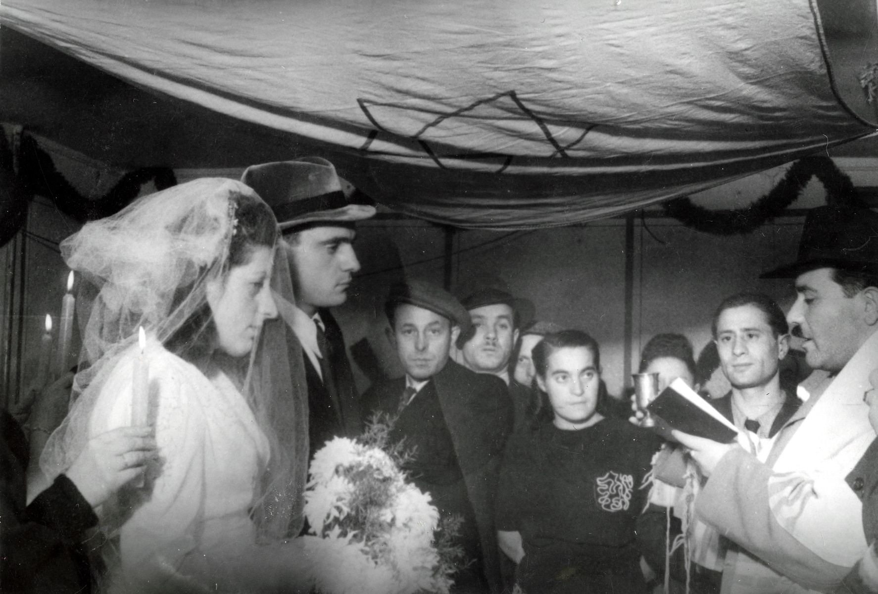 Rabbi Yehuda Lipot Meisels conducts a wedding in the Pocking displaced persons camp.