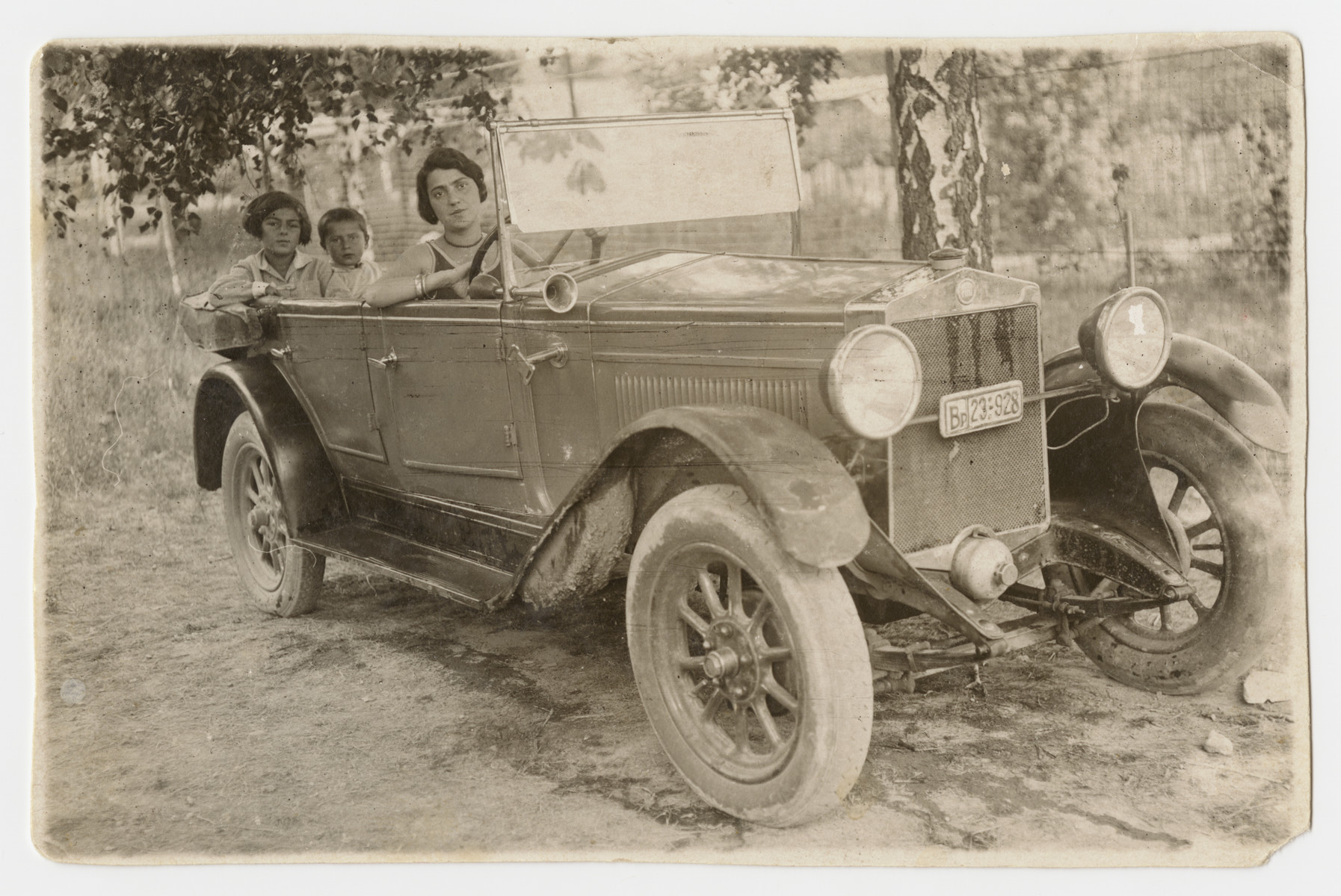 Family goes for a ride in their private automobile.  Pictured are Sara Koranyi and her children Marta and Erwin.