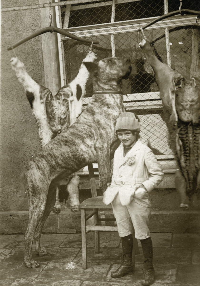 Erika Meyer stands by two butchered animals and a large dog while visiting her grandparents in Neuwied, Germany near Koblenz.