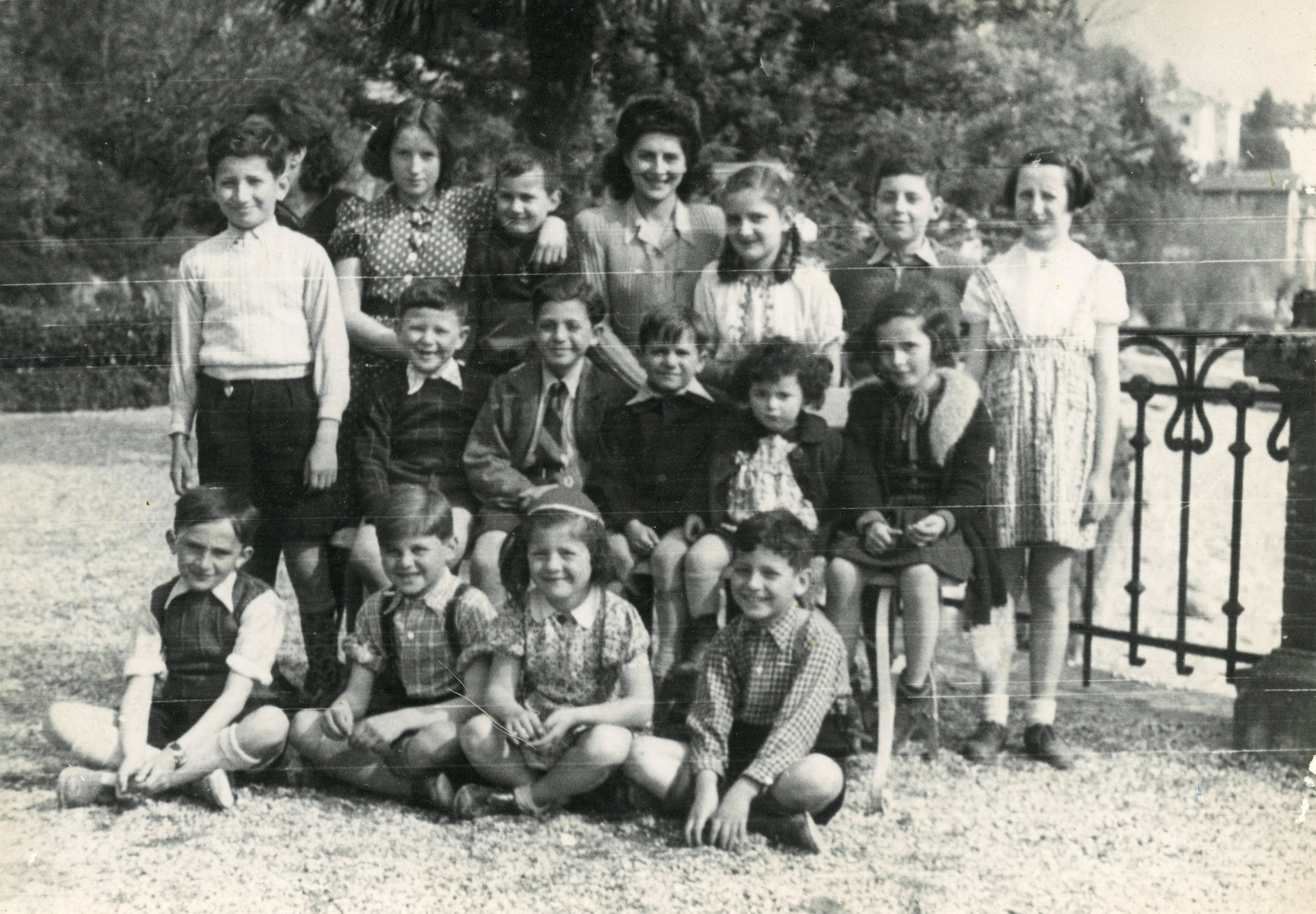 Group portrait of Jewish refugee children in the children's home in Ascona, Switzerland  Mirjam Ermann is in the middle row on the far right .  Her sister Suzanne is next to her.