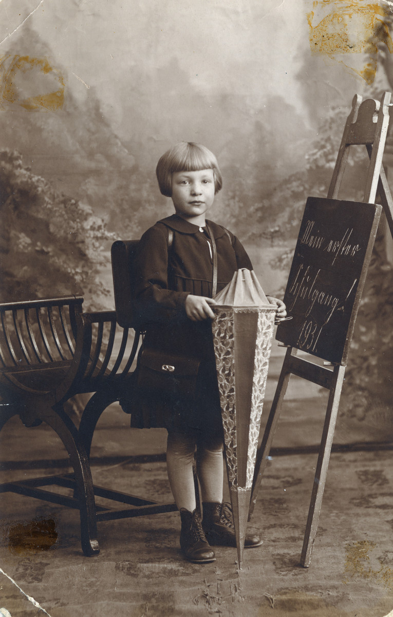 Studio portrait of Lilli Drabinawski on her first day of school.