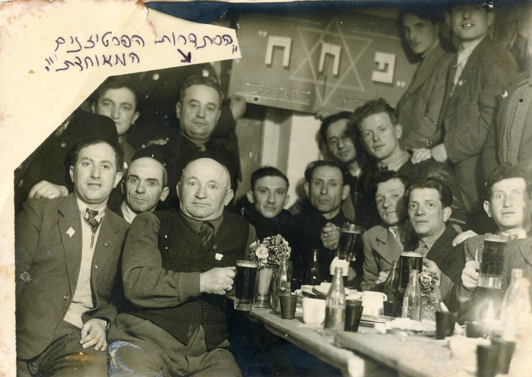Former partisans and members of HaHistadrut Hapartisanim Ha'Meuchedet, gather for a celebration at the end of the war.   Zvi Szklut is on the far left.