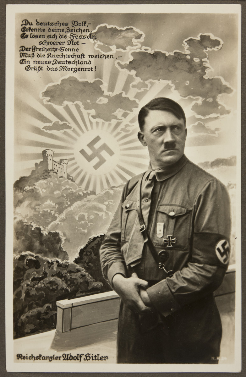 """Nazi propaganda depicting Adolf Hitler as Reich Chancellor before a rising sun with a swastika at its center.    The text reads:  """"You, German people,  Behold your emblem,  The shackles of poverty have given way, The sun of freedom leads you from serfdom. A new Germany greets the dawn!"""""""