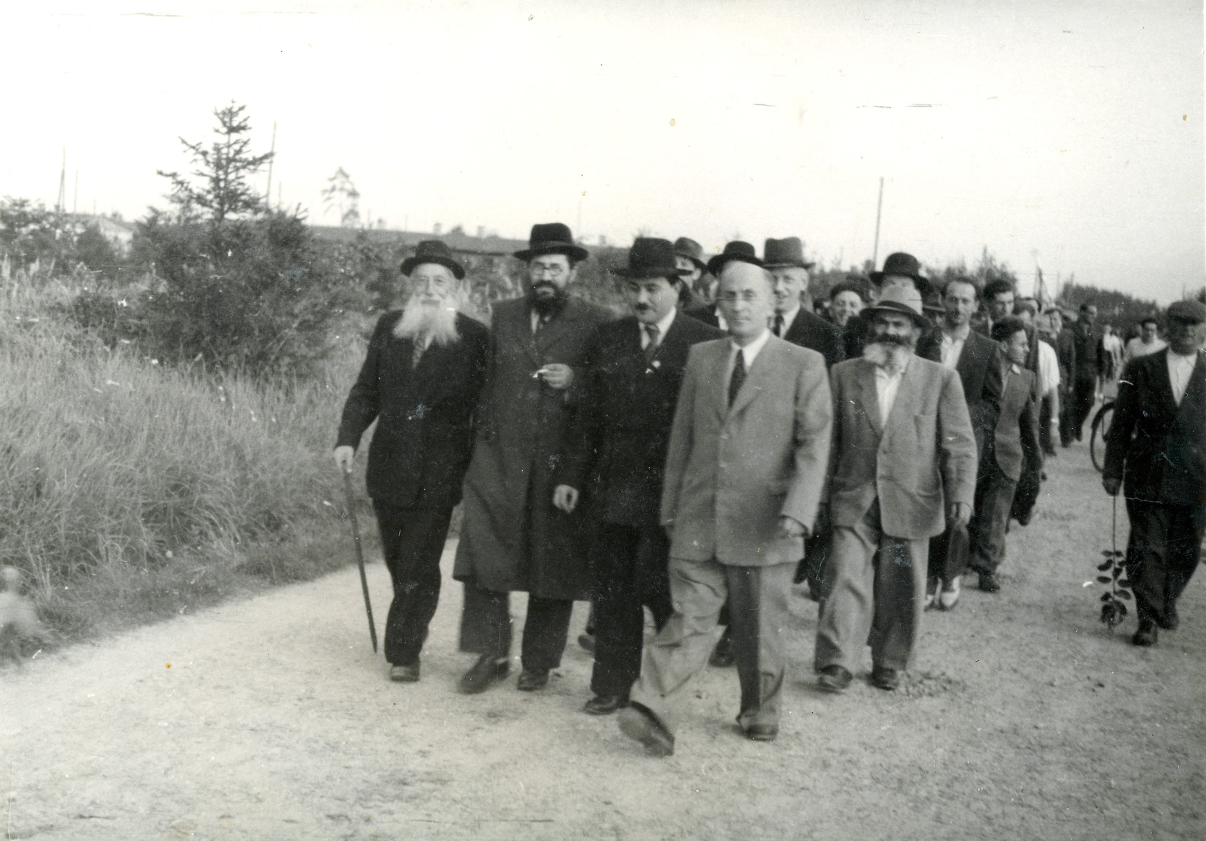 Rabbi Yehuda Lipot Meisels (front row, second from right) leads a procession to the dedication of a monument to the victims of the Pocking concentration camp.