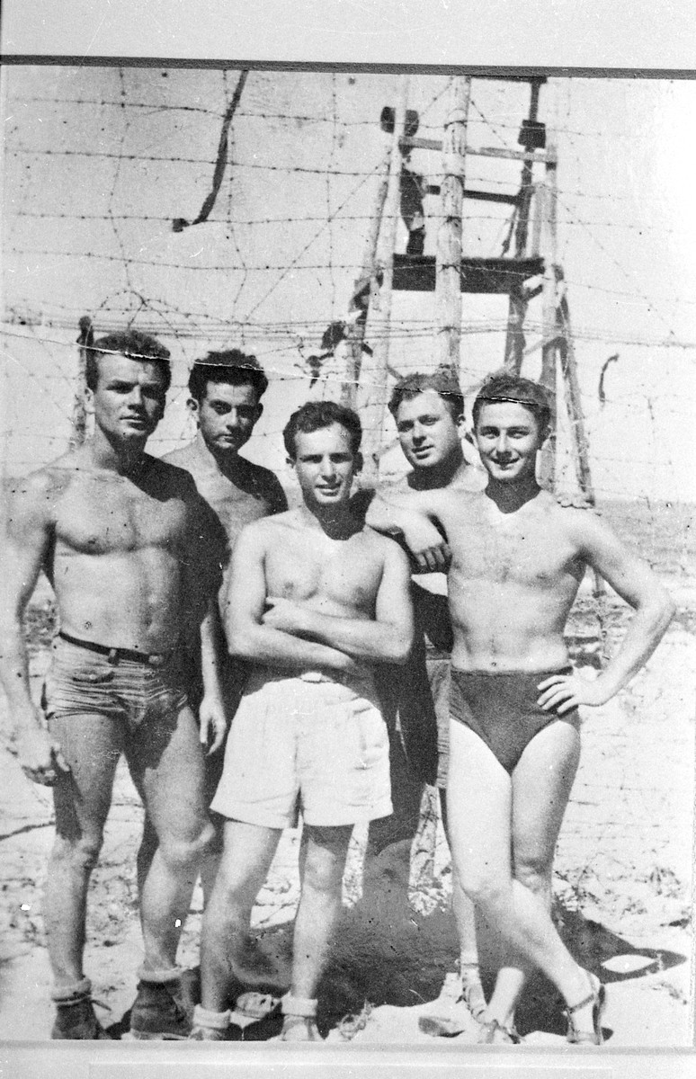 Murray Greenfield (far right) and other American volunteers who worked on behalf of immigration to Palestine stand in front of a British guard station in the Cyprus internment camp.