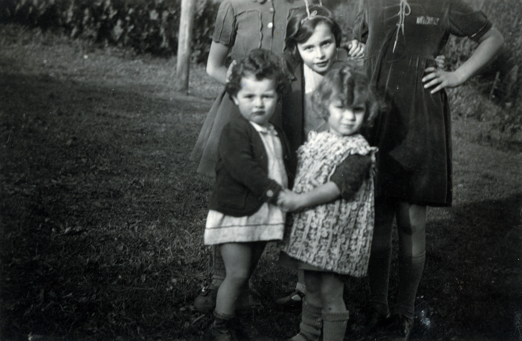 Mirjam Ermann stands behind her sister Suzanne (left) and another young girl in the children's home in Ascona.