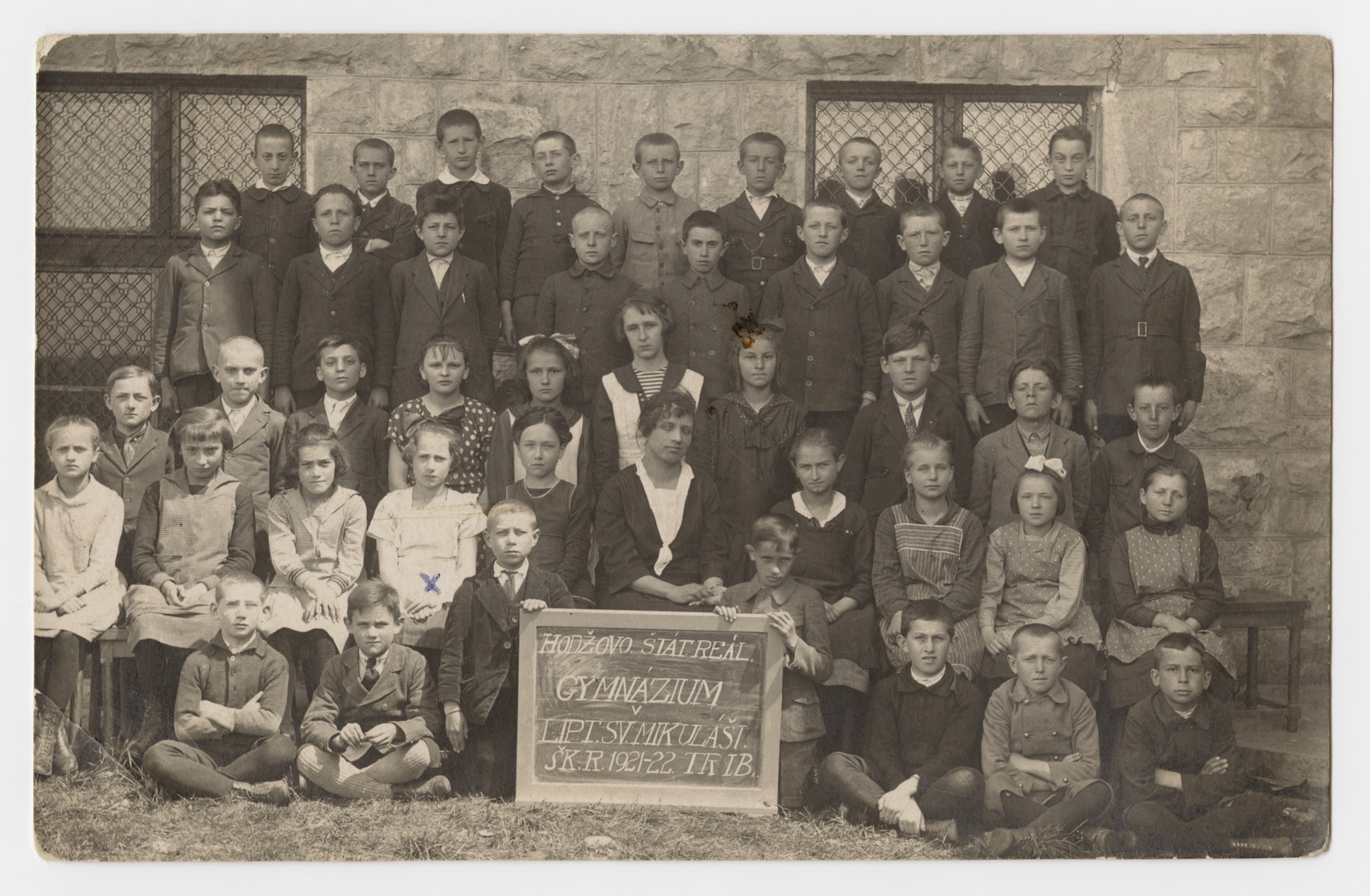 Group portrait of students at the public school in Liptovsky Mikulas.  Hedwig Schwalb is pictured seated fourth from the left.
