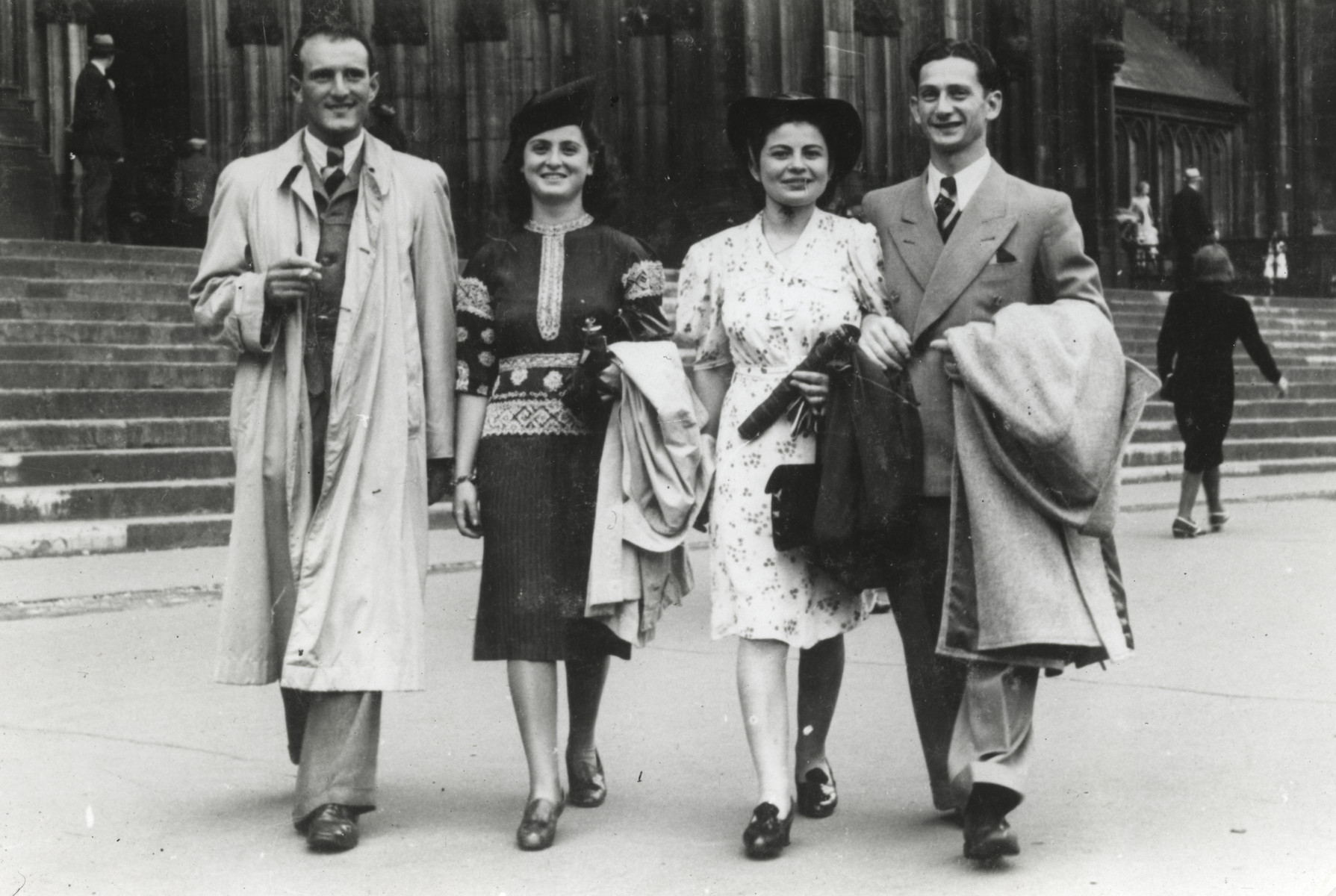 Two Jewish couples walk down a street in Bonn, Germany.  On the left are Herbert and Ruth Meyer who were later deported to Auschwitz.