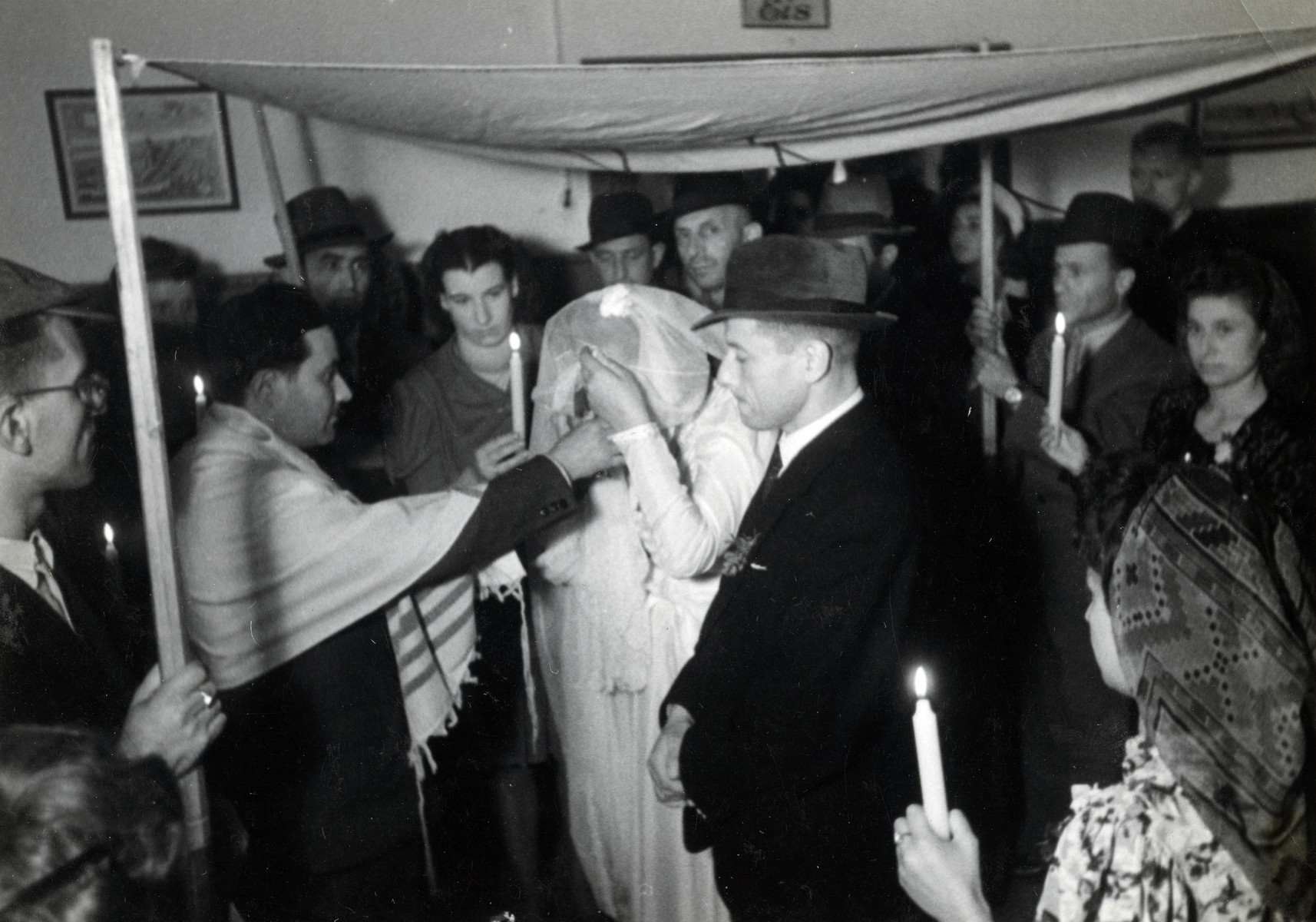 Rabbi Yehuda Lipot Meisels officiates at a wedding in the Pocking displaced persons camp.
